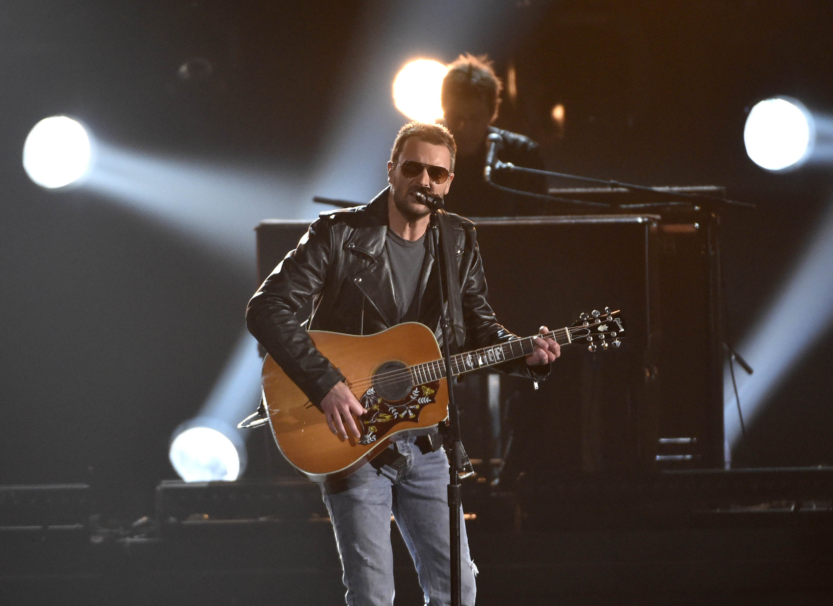 FILE - In this Nov. 4, 2015, file photo, Eric Church performs at the 49th annual CMA Awards at the Bridgestone Arena in Nashville, Tenn. Church and Chris Stapleton lead the early nominees for the 51st annual Academy of Country Music Awards with three nominations each, including male vocalist and album of the year. ACM Awards co-host Dierks Bentley announced the nominees Monday, Feb. 1, 2016, for six categories. (Photo by Chris Pizzello/Invision/AP, File)