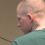 Standoff suspect appears in court, facing firearms charges