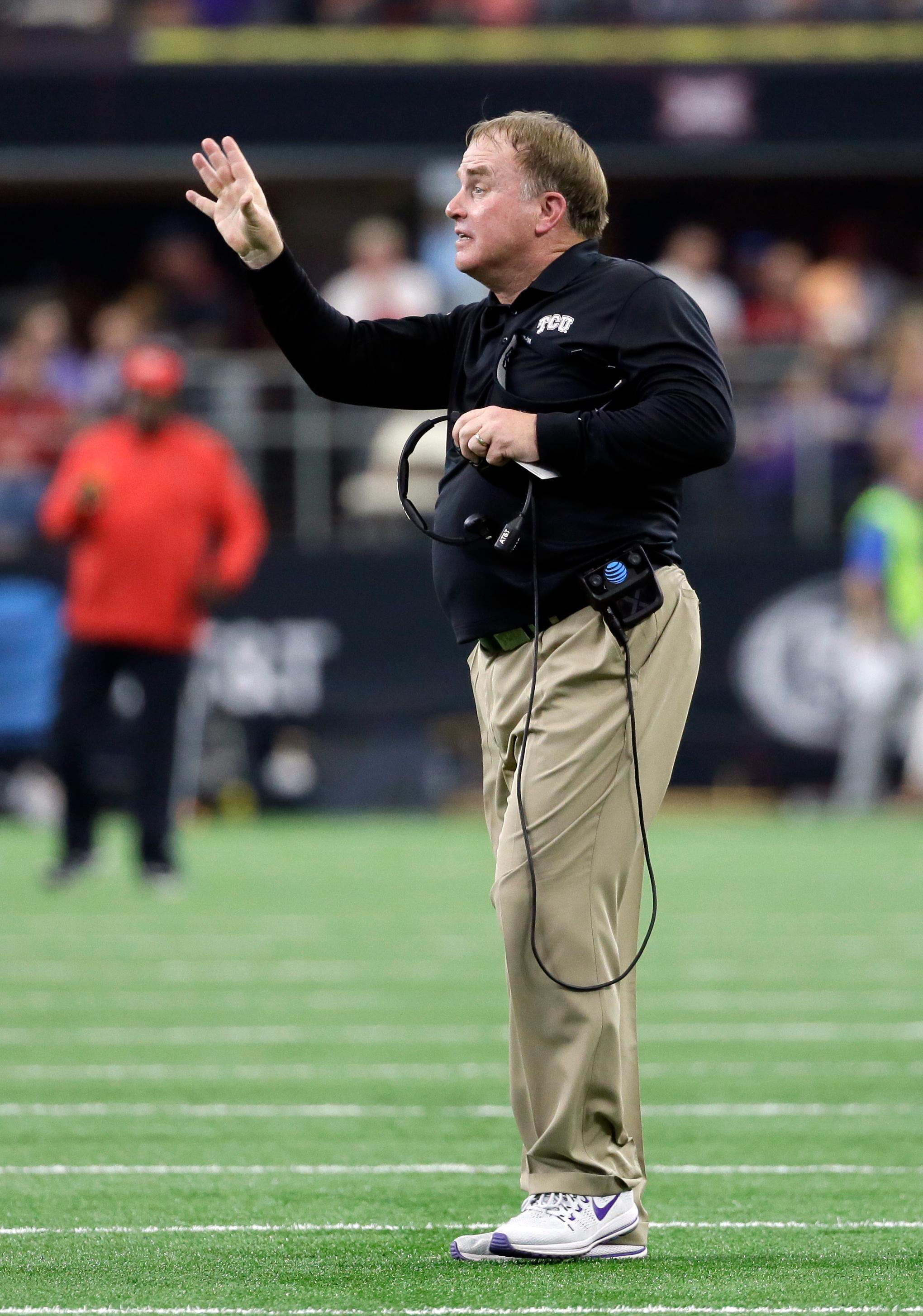 TCU head coach Gary Patterson signals to his defense in the first half of the Big 12 Conference championship NCAA college football game against Oklahoma on Saturday, Dec. 2, 2017, in Arlington, Texas. (AP Photo/Tony Gutierrez)