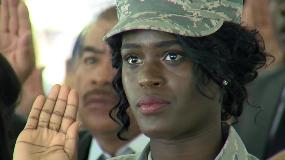 Soldier salutes during pledge of allegiance at U.S. citizenship naturalization ceremony, Mount Pleasant, SC, Nov. 1 (WCIV).jpg