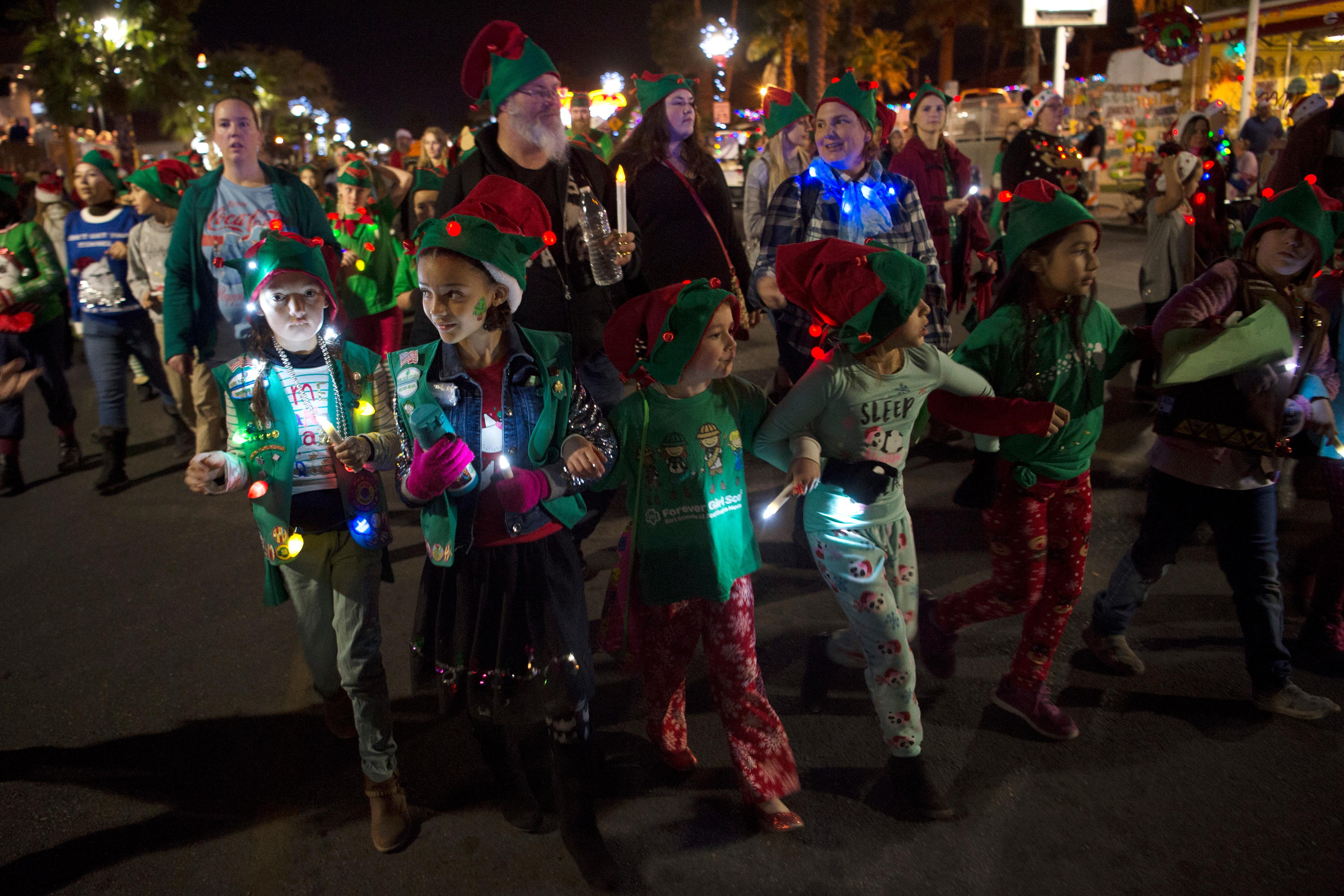 Girl Scouts march down Nevada Way during the Santa's Electric Parade Saturday, December 2, 2017, in Boulder City. [Sam Morris/Las Vegas News Bureau]