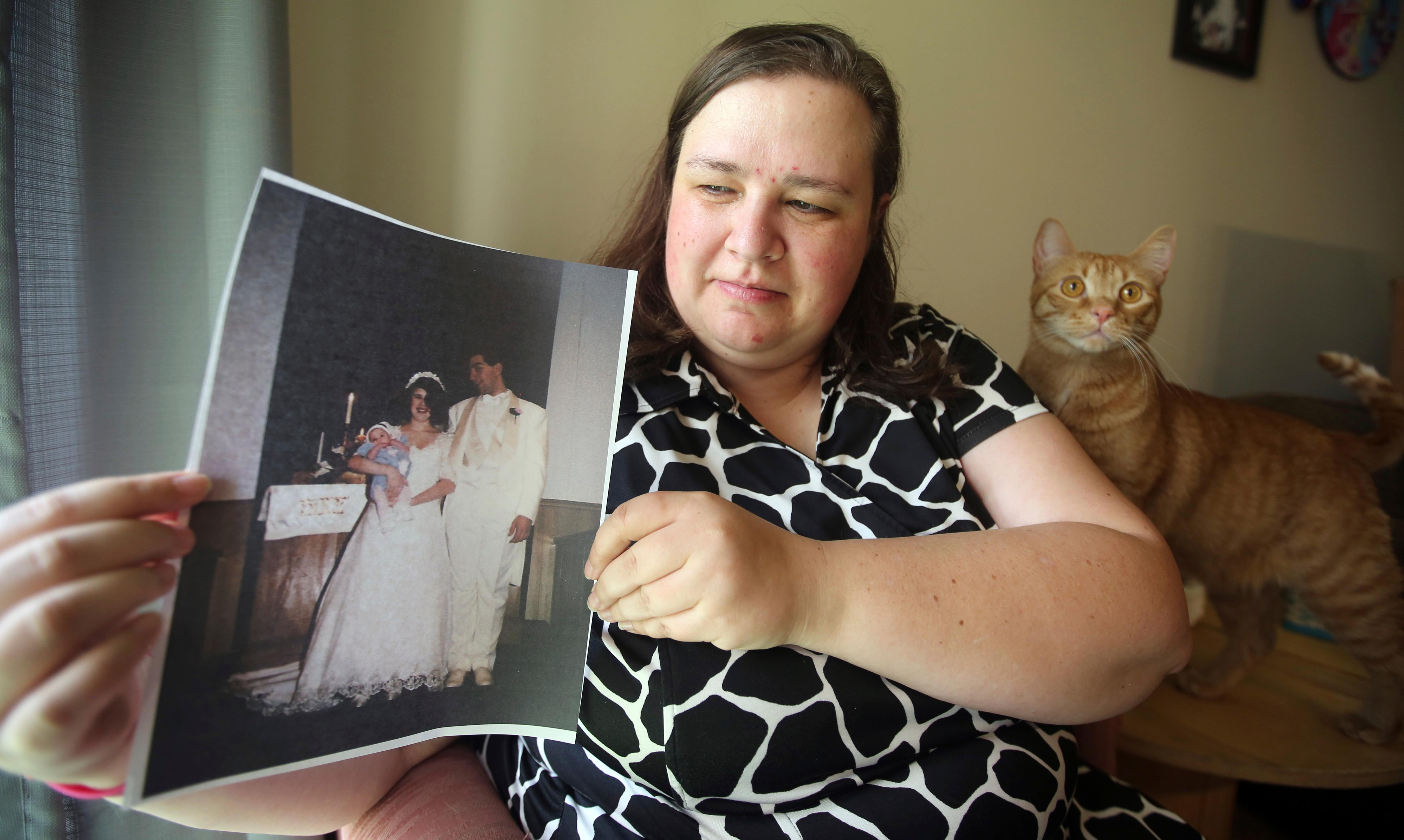 "Heidi Clark holds a photograph from her 1995 wedding at her home in Orem, Utah, on Friday, May 18, 2018. Clark became pregnant at 16 and married soon after, under pressure from her boyfriend's religious community of Seventh-Day Adventists in Pennsylvania, she said. ""I always felt a little bit like I was trapped,"" Clark said, now 40. ""I was 17. I was so young."" Utah state Rep. Angela Romero wants to ban marriage for anyone under 18 as part of a national push to outlaw underage marriage. (AP Photo/Rick Bowmer)"