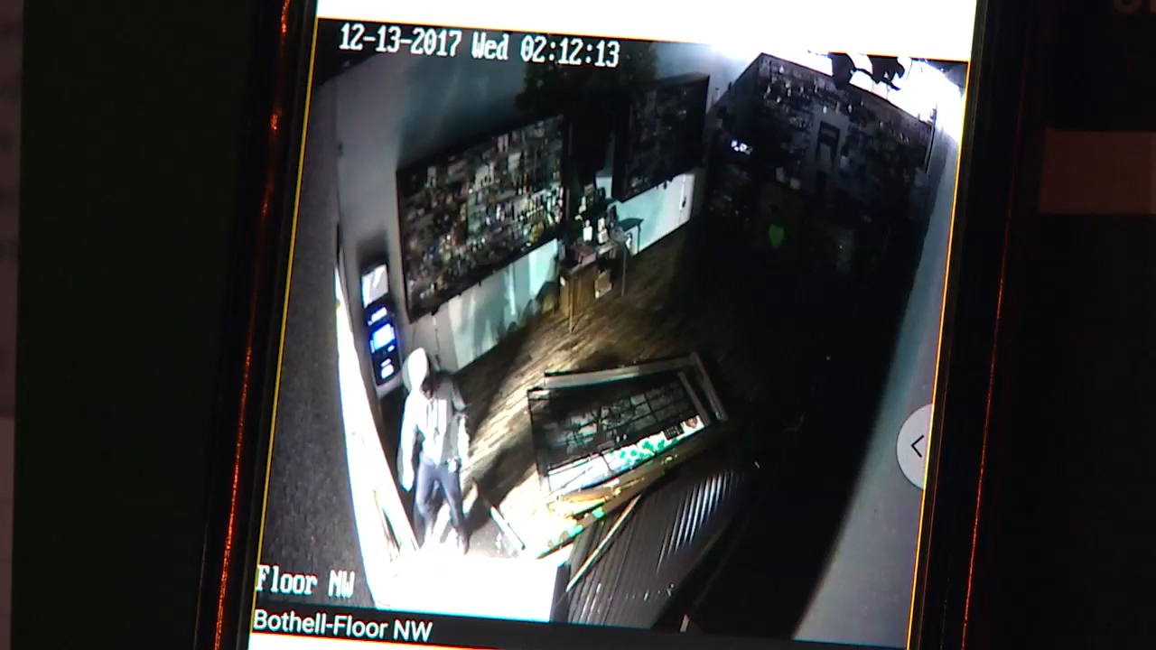 Screenshot from surveillance video shows suspects inside the pot store.