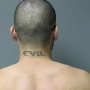 UPDATE: Police release photos of tattoos on escaped inmate