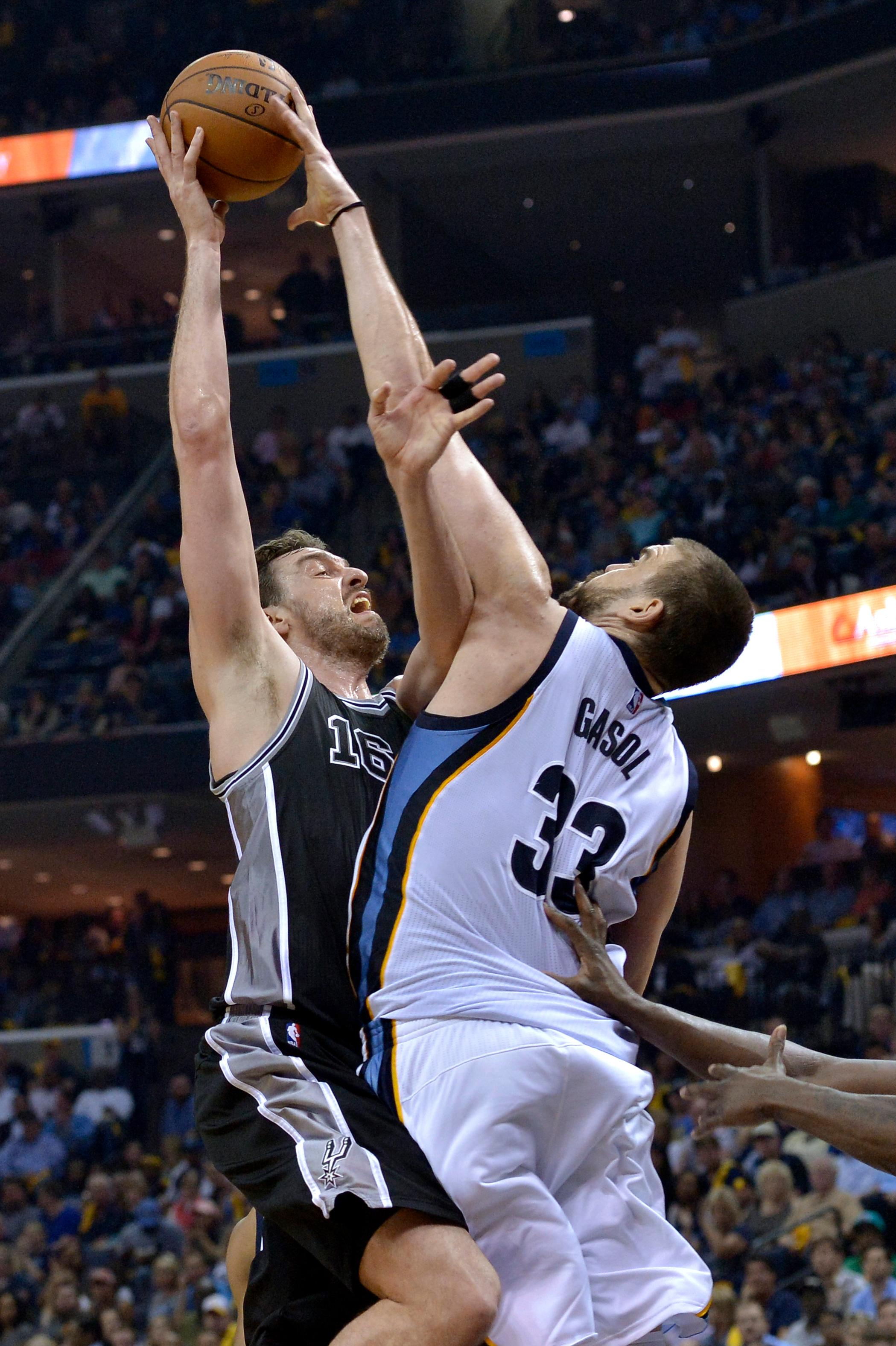 Memphis Grizzlies center Marc Gasol (33) blocks a shot by San Antonio Spurs center Pau Gasol (16), his brother, during the second half of Game 3 in an NBA basketball first-round playoff series Thursday, April 20, 2017, in Memphis, Tenn. (AP Photo/Brandon Dill)