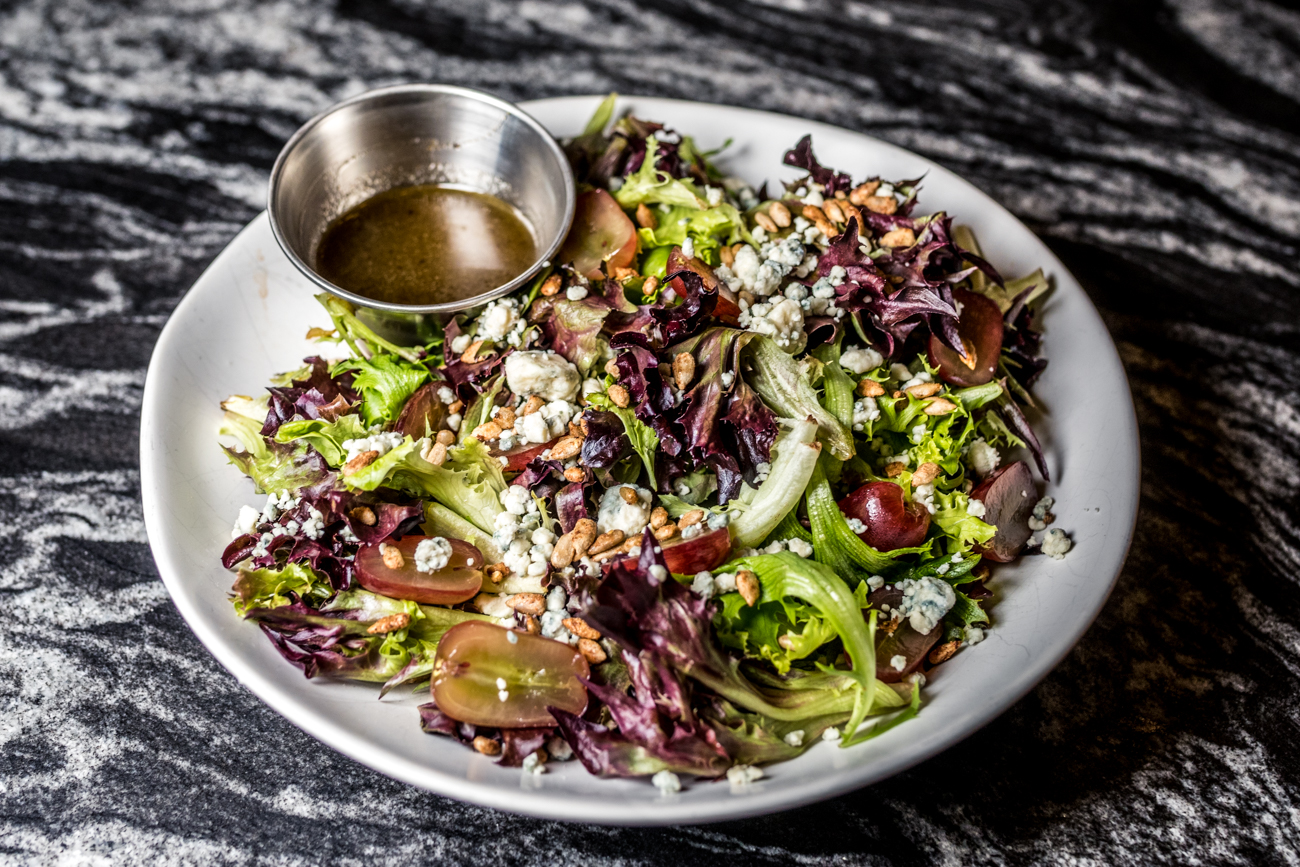 House Salad: honey balsamic, grapes, toasted sunflower seeds, and blue cheese / Image: Catherine Viox // Published: 6.29.20
