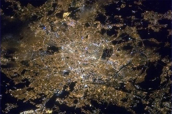 Paris, well-named City of Light. Even from orbit the brilliant Champs-Elysees is visible.  (Photo & Caption: Chris Hadfield/NASA)