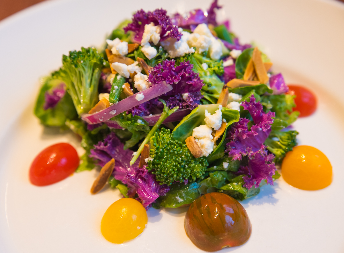 Kale and Broccoli Salad: baby kale, broccoli, arugula, Brussels sprouts, haricot verts, cucumber, red onion, heirloom tomatoes, toasted almonds, and feta cheese with citrus vinaigrette / Image: Sherry Lachelle Photography // Published: 3.21.18<br><p></p>