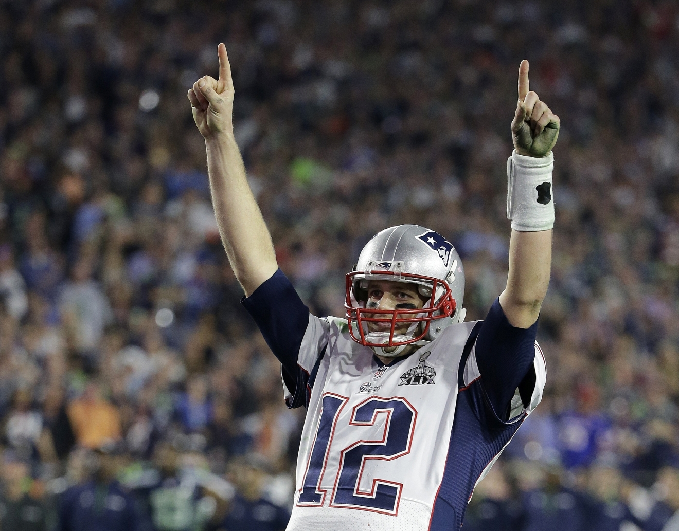 "FILE - In this Feb. 1, 2015, file photo, New England Patriots quarterback Tom Brady (12) celebrates during the second half of NFL Super Bowl XLIX football game against the Seattle Seahawks, in Glendale, Ariz. Brady's missing jersey from the Super Bowl has been found in the possession of a member of the international media.  The NFL said in a statement Monday, March 20, 2017,  that his jersey was found through the ""cooperation of the NFL and New England Patriots' security teams, the FBI and other law enforcement authorities."" Brady said his jersey went missing after the Patriots' 34-28 win last month over the Atlanta Falcons.  The statement also said an ongoing investigation retrieved the jersey Brady wore in the Patriots' 2015 Super Bowl win against the Seahawks. (AP Photo/Kathy Willens, File)"