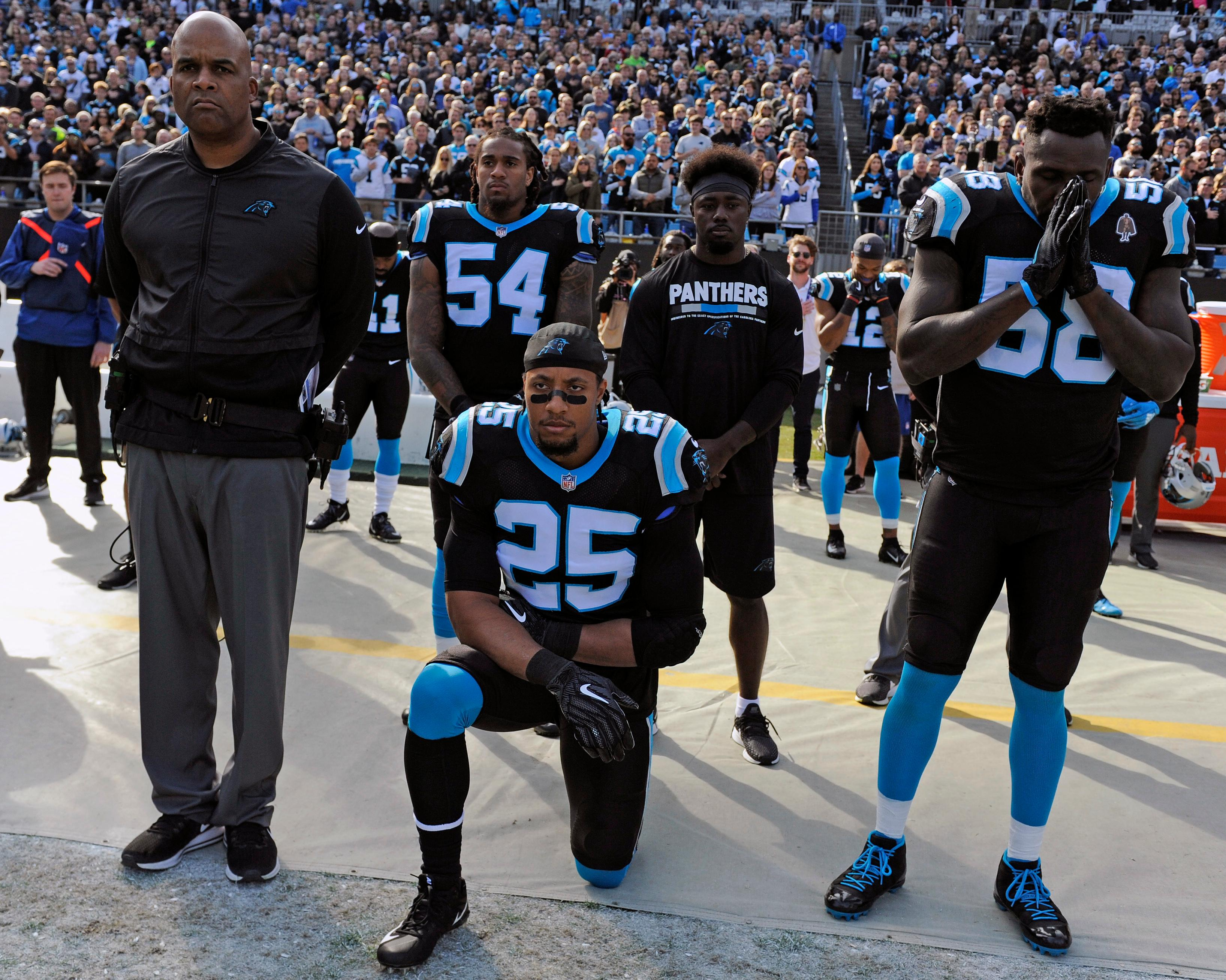 "FILE - In this Nov. 25, 2018, file photo, Carolina Panthers' Eric Reid (25) kneels during the national anthem before an NFL football game against the Seattle Seahawks, in Charlotte, N.C. The NFL and the NFL Players Association has released a joint statement saying an independent administrator found Panthers safety Eric Reid received the ""normal"" number of drug tests this season and he was not the subject of targeting by the league. Reid said in December he had been tested seven times by the NFL. He said the league was targeting him because of the ongoing collusion case against the NFL alleging that team owners conspired to keep him out of the league because of his decision to kneel during the national anthem to protest racial and social injustice. (AP Photo/Mike McCarn, File)"