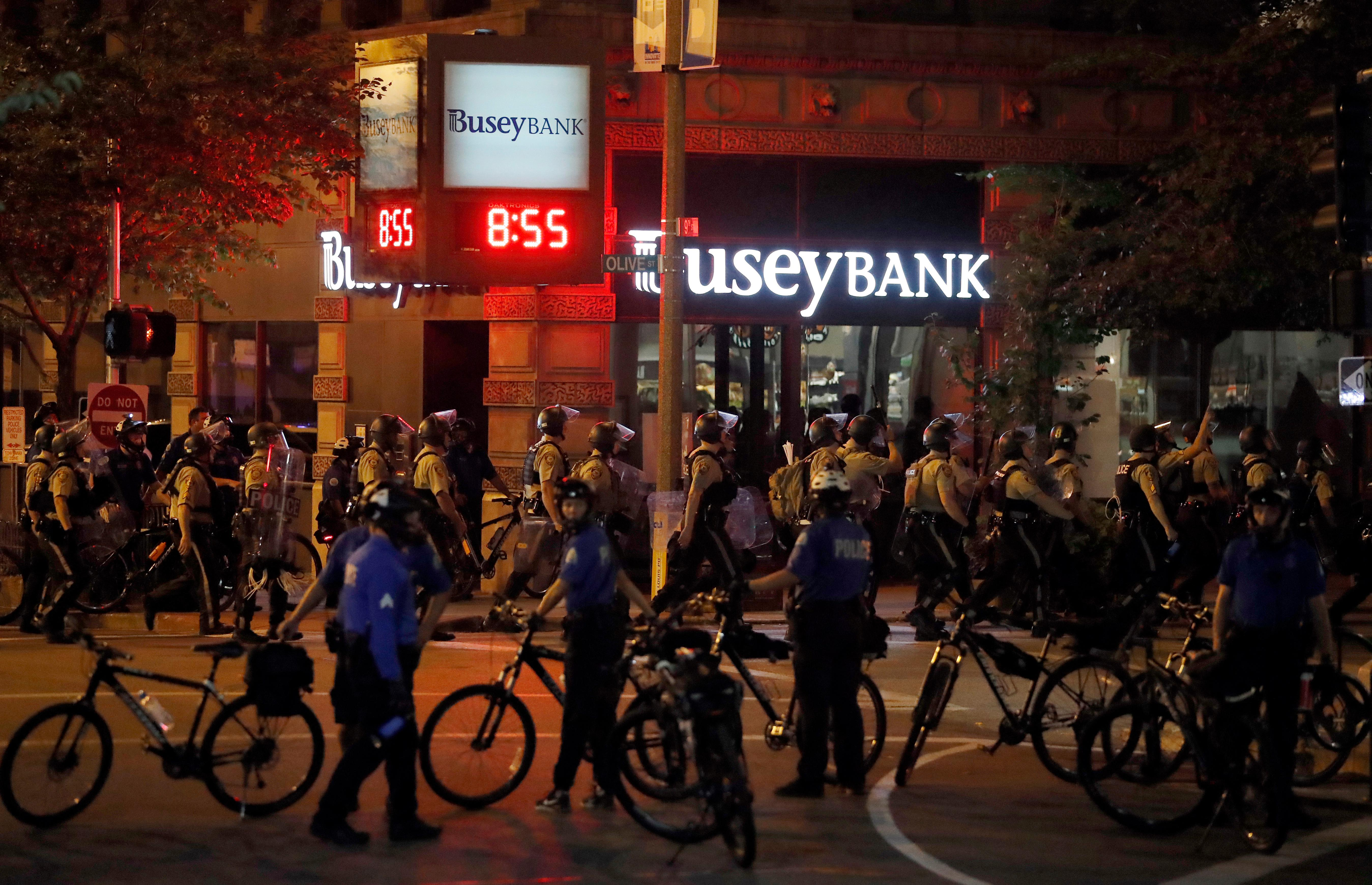 Police gather as demonstrators march in response to a not guilty verdict in the trial of former St. Louis police officer Jason Stockley, Sunday, Sept. 17, 2017, in St. Louis. Stockley was acquitted in the 2011 killing of a black man following a high-speed chase. (AP Photo/Jeff Roberson)