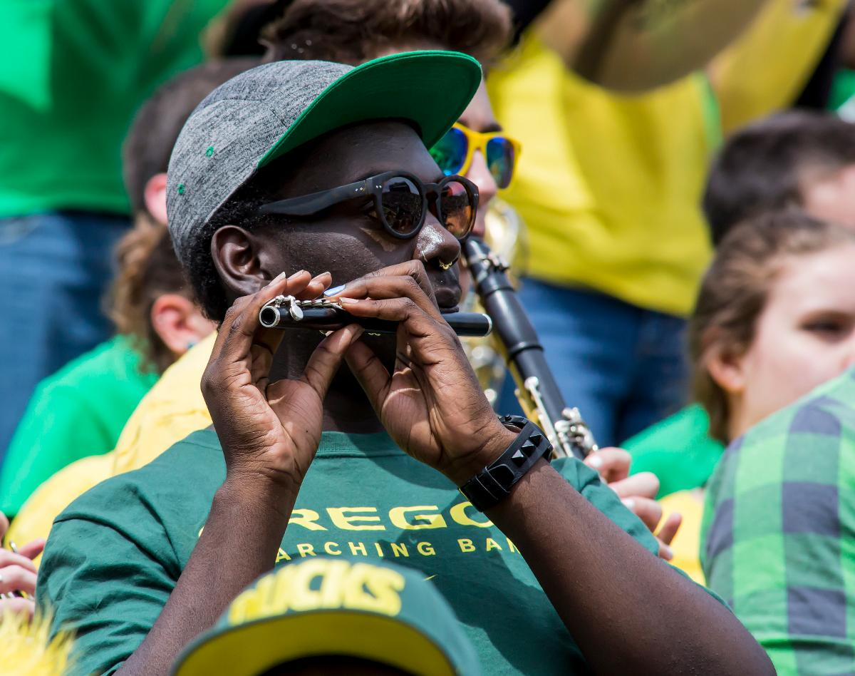 Amember of the Oregon Marching Band plays a wind instrument. The 2017 Oregon Ducks Spring Game provided fans their first glimpse at the team under new Head Coach Willie Taggart's direction. Team Free defeated Team Brave 34-11 on a sunny dat at Autzen Stadium in Eugene, Oregon. Photo by Ben Lonergan, Oregon News Lab