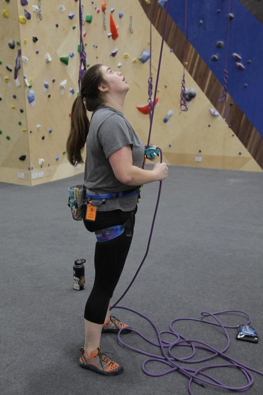 A woman belays her partner, keeping a close eye on them in case of a slip or fall. If her partner were to slip or fall, she would arrest their fall via the belay device attached to her climbing harness. / Image: Chez Chesak // Published: 2.1.20