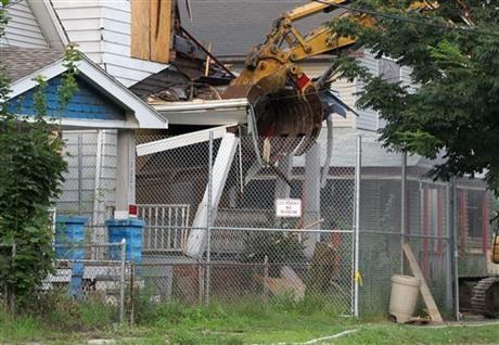 The home of Ariel Castro is torn down in Cleveland on Wednesday as part of a deal that spared Ariel Castro a possible death sentence. He was sentenced last week to life in prison plus 1,000 years.