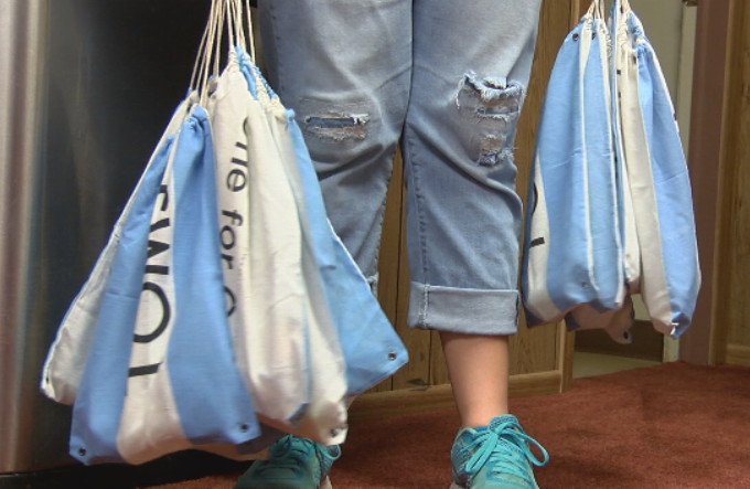 No Boundaries International volunteers take bags with food and toiletries to hand out during its street outreach efforts. (KVII, Niccole Caan)<p></p>