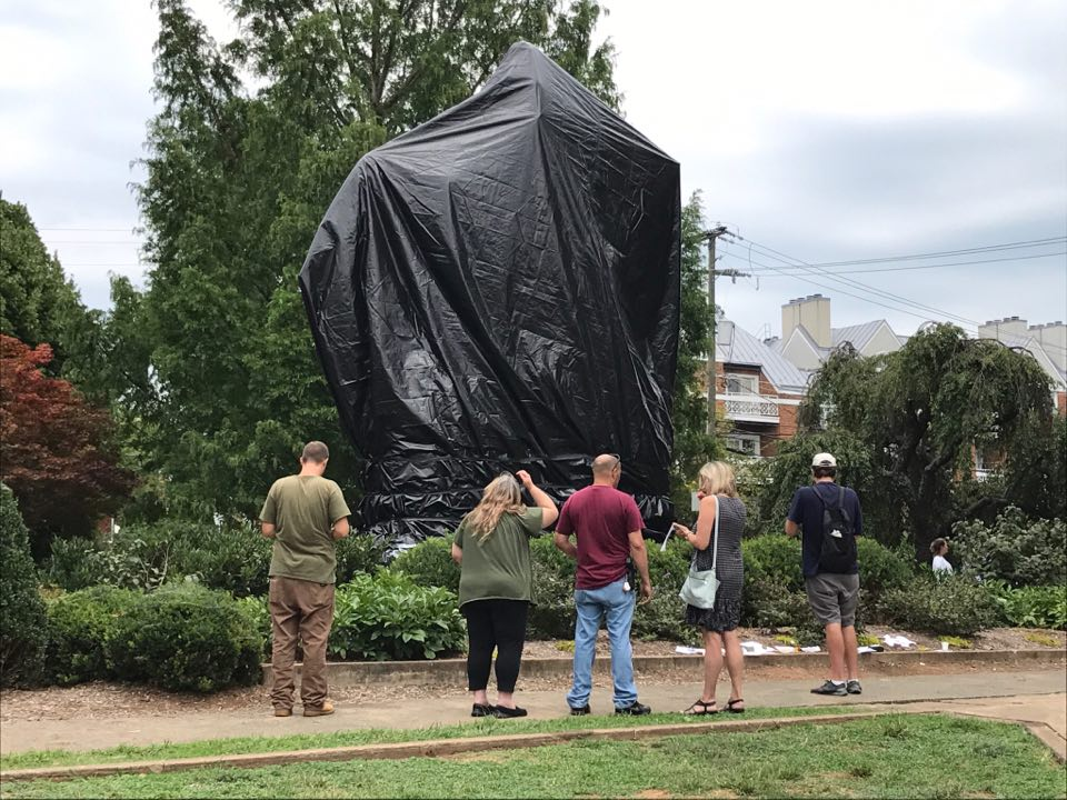 The Robert E. Lee statue covered in a black tarp (Photo: WSET)