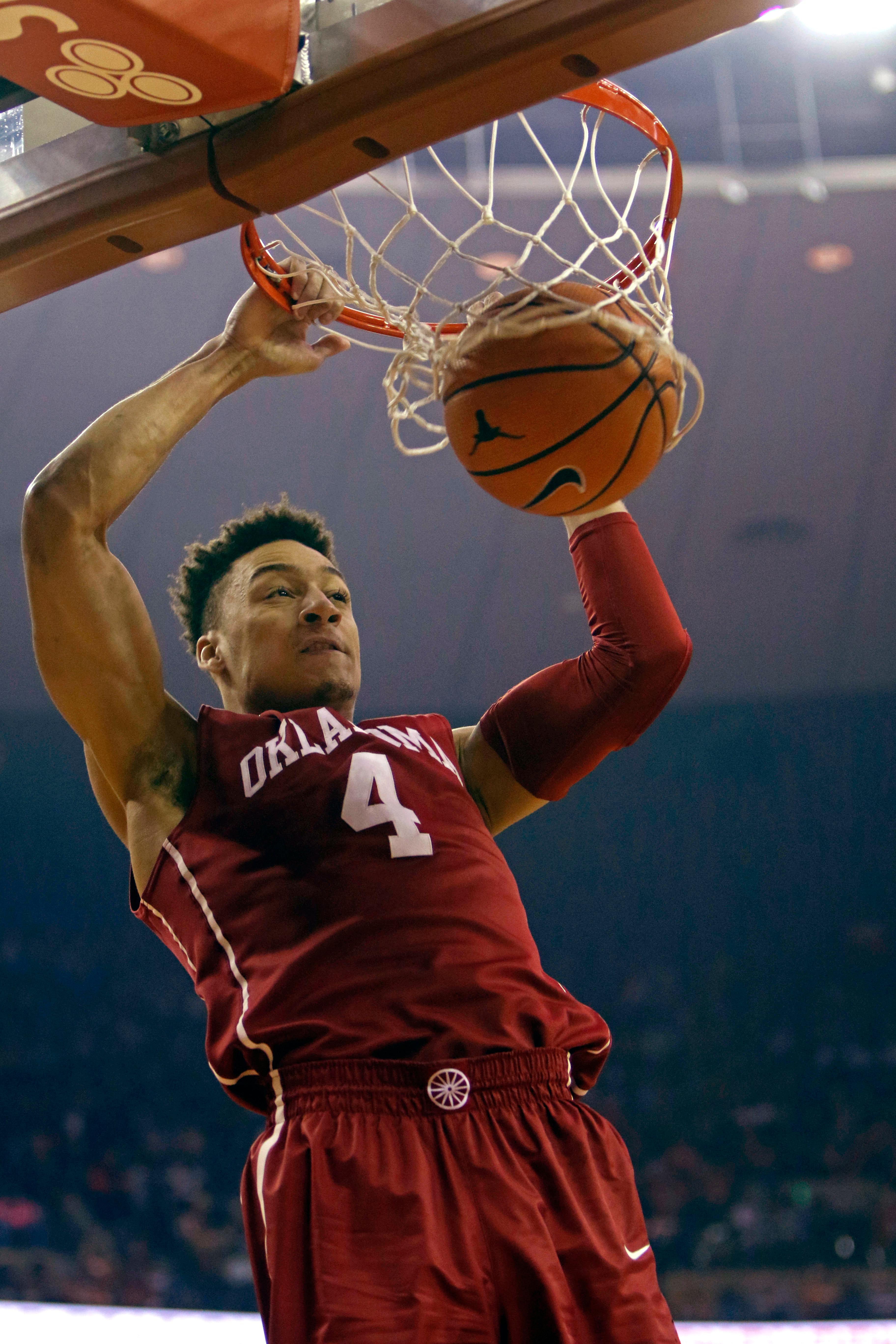 Oklahoma center Jamuni McNeace dunks during the first half of an NCAA college basketball game against Texas, Saturday, Feb. 3, 2018, in Austin, Texas. (AP Photo/Michael Thomas)