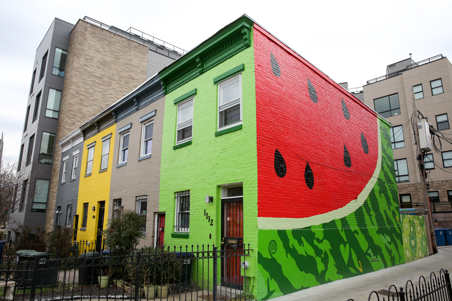 The Watermelon House in Shaw might be one of the cutest pieces of public art in D.C.! The super bright mural at{ }1112 Q St NW also has a few hidden hearts. Don't skip out on taking photos of the adjacent kiwi wall too. (Amanda Andrade-Rhoades/DC Refined)