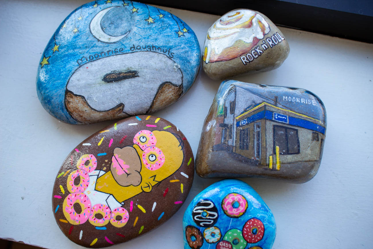 Some painted doughnut-themed rocks left by members of the NKY Hidden Rock group. / Image: Katie Robinson, Cincinnati Refined // Published: 10.20.19