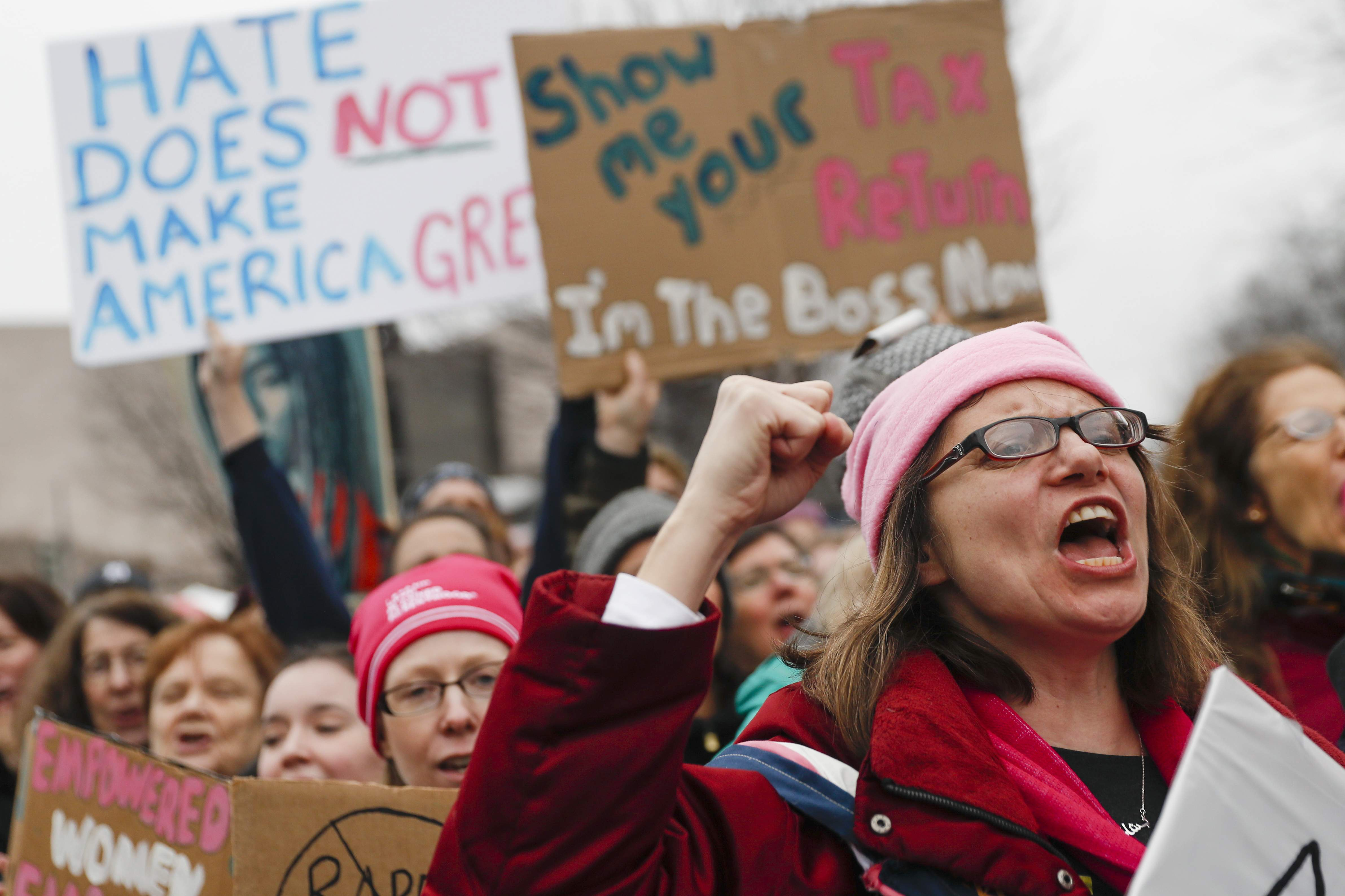 Protesters cheer at the Women's March on Washington during the first full day of Donald Trump's presidency, Saturday, Jan. 21, 2017 in Washington. THE ASSOCIATED PRESS
