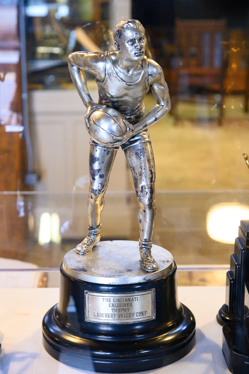 Old sports trophies dating back many decades are on display. / Image: Phil Armstrong, Cincinnati Refined // Published: 1.7.20