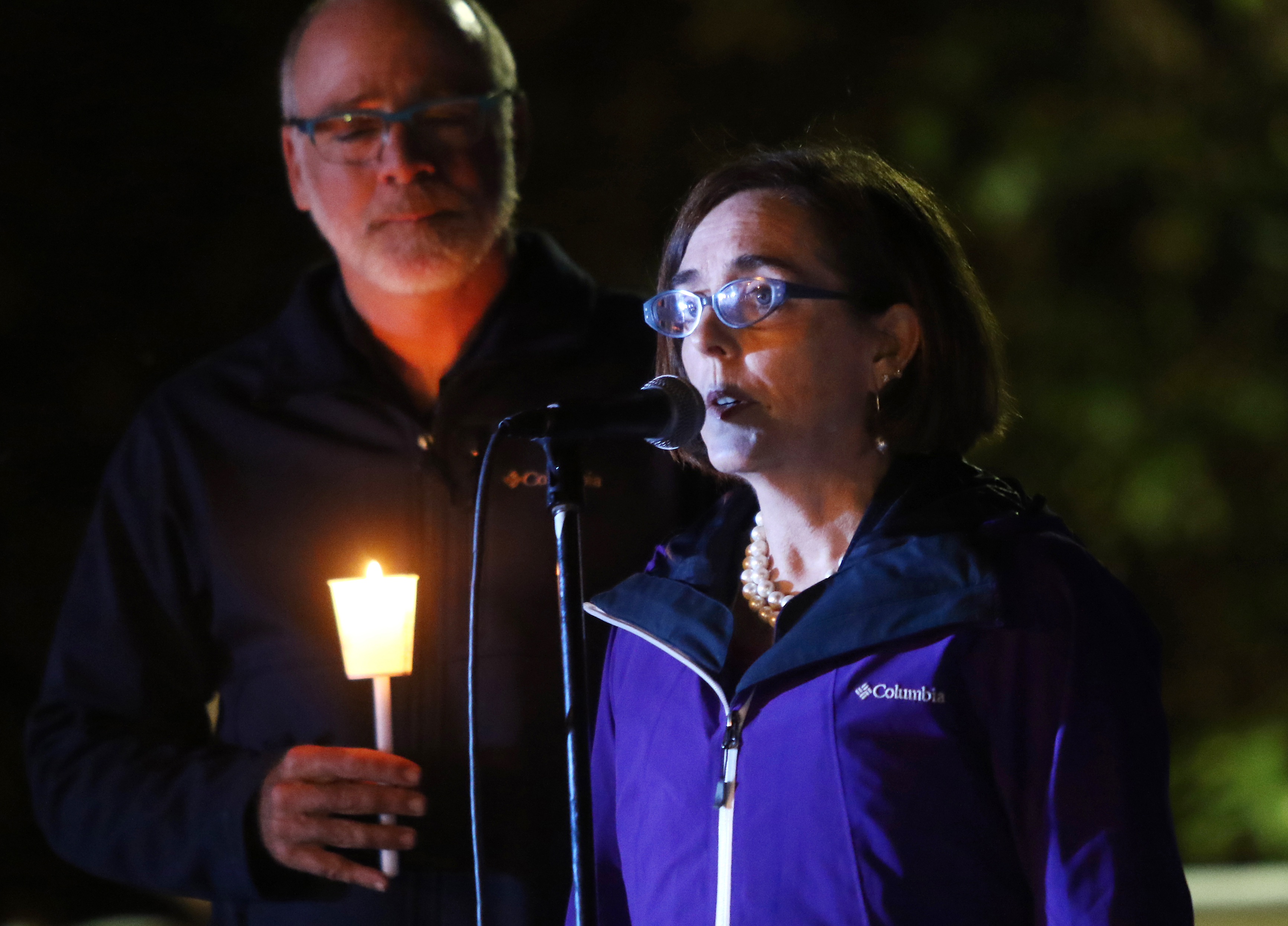 Oregon Gov. Kate Brown addresses community members gathered at a candlelight vigil for those killed during a shooting at Umpqua Community College in Roseburg, Ore., Thursday, Oct. 1, 2015. (Michael Sullivan/The News-Review via AP) MANDATORY CREDIT