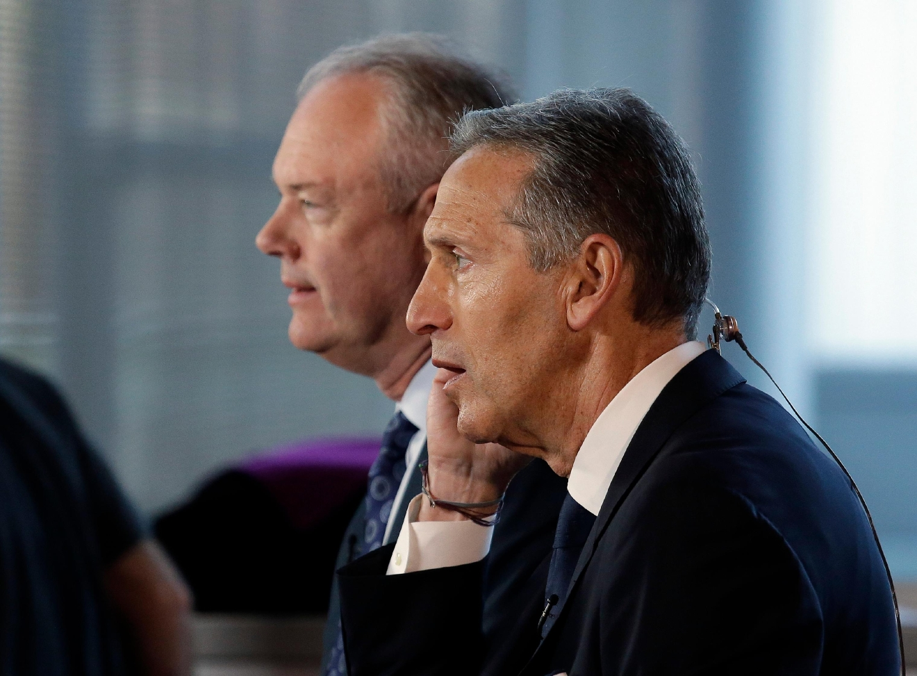 Starbucks CEO Howard Schultz, right, sits with President and Chief Operating Officer Kevin Johnson for a television interview before the company's annual shareholder meeting, Wednesday, March 22, 2017, in Seattle. Johnson takes over as CEO from Schultz, who will become executive chairman, in April. (AP Photo/Elaine Thompson)