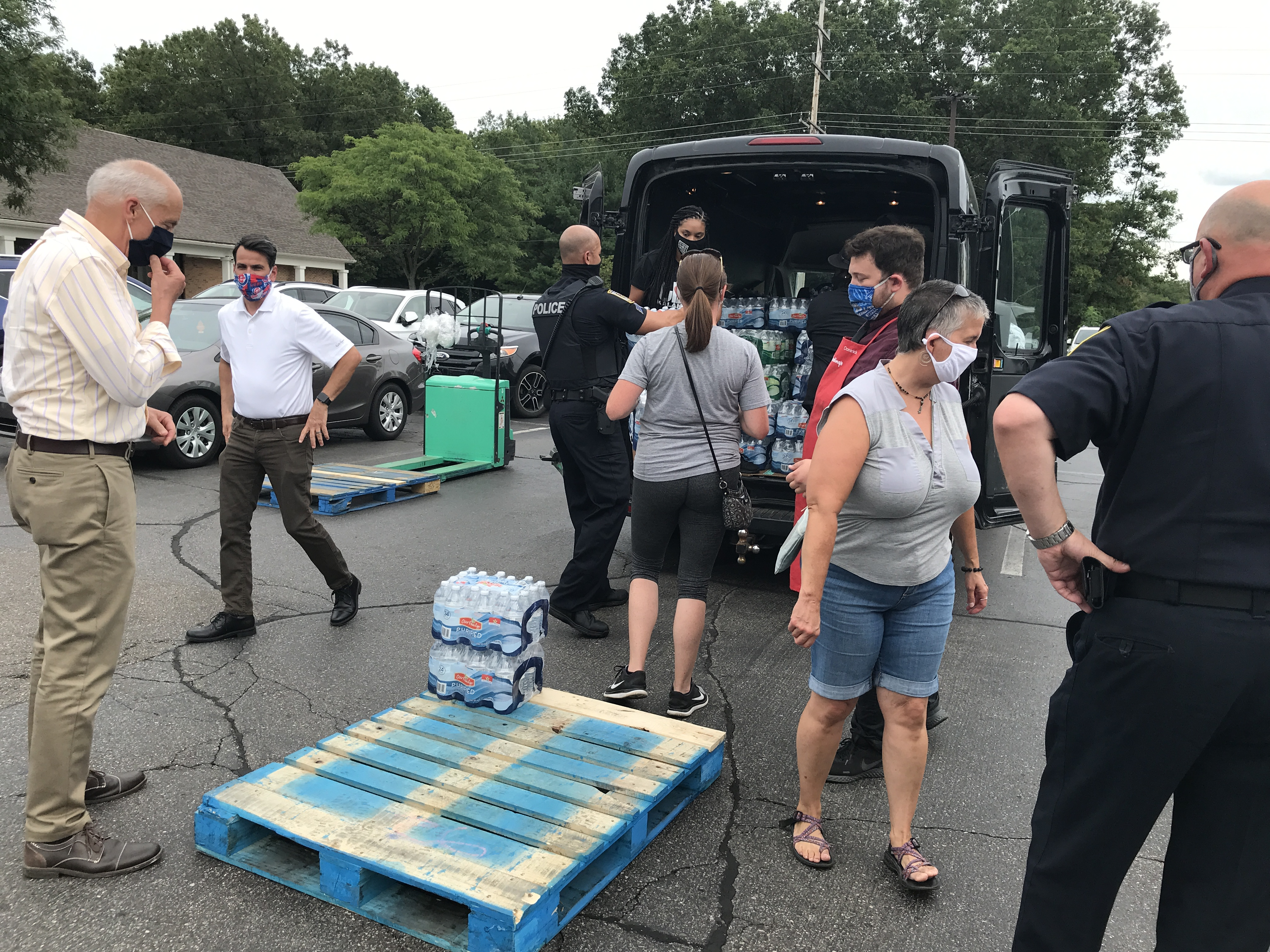 The final two cases of water await loading up onto the truck Thursday July 30, 2020.{ } Harding's donated two pallets worth, to give to Village in the Valley which will go to Flint in early August.{ } (WWMT/Jason Heeres)