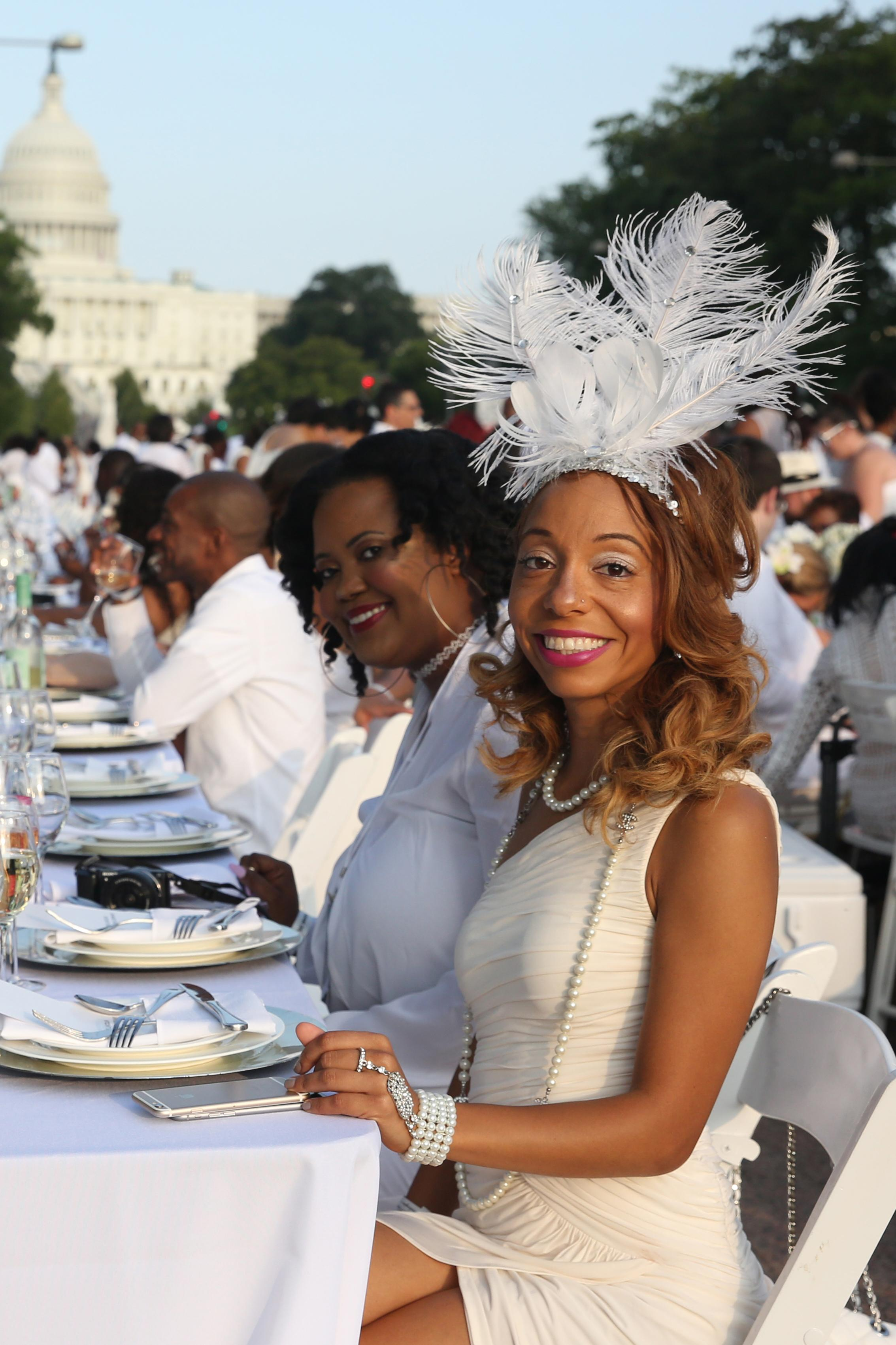 Diner en Blanc has a pretty strict dress code - all white everything. Still, the outfits are anything but boring! Here are some of our favorite looks from Diner en Blanc. (Amanda Andrade-Rhoades/DC Refined)