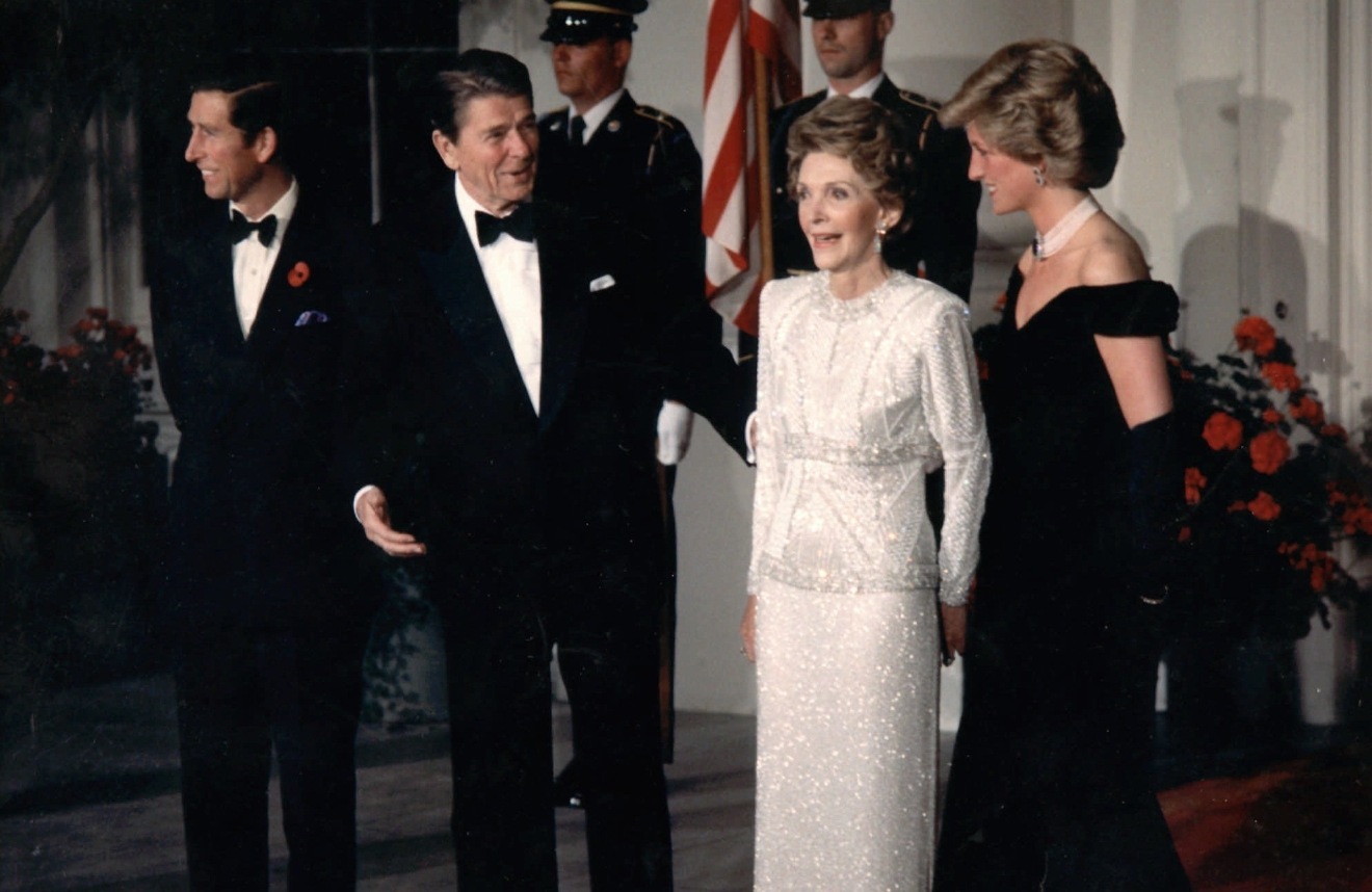 "FILE - In this Nov. 9, 1985 file photo, Diana, Princess of Wales, left, speaks with U.S President Ronald Reagan and his wife Nancy during a visit to the White House in Washington. This outfit is featured in an exhibition of 25 dresses and outfits worn by Diana entitled ""Diana: Her Fashion Story"" at Kensington Palace in London, opening on Friday, Feb. 24, 2017. (AP Photo,file)"