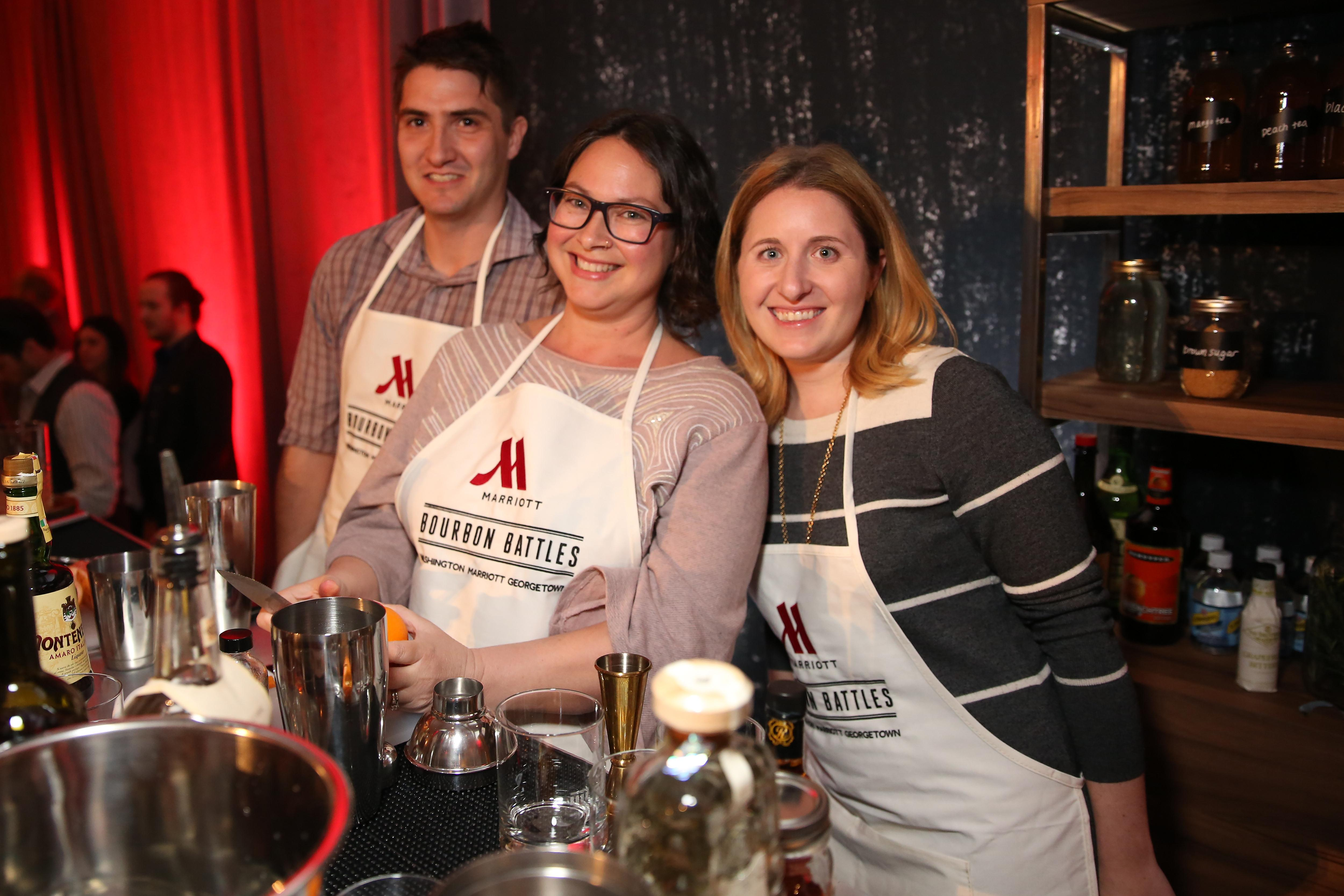 Fortunately for the journalists, they only had to battle each other - not the pro bartenders in the room. From left, Travis Mitchell, Rina Rapuano and Laura Wainman. (Amanda Andrade-Rhoades/DC Refined)