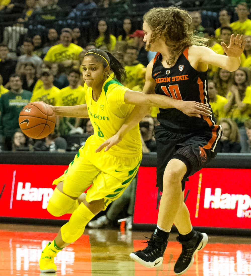 Oregon Ducks Guard Justine Hall (#3) drives past Guard Katie Mcwilliams (#10) to get into the lane. Oregon Ducks lost 40-43 to Oregon State Beavers in a tightly matched fourth quarter. Photo by Jonathan Booker, Oregon News Lab