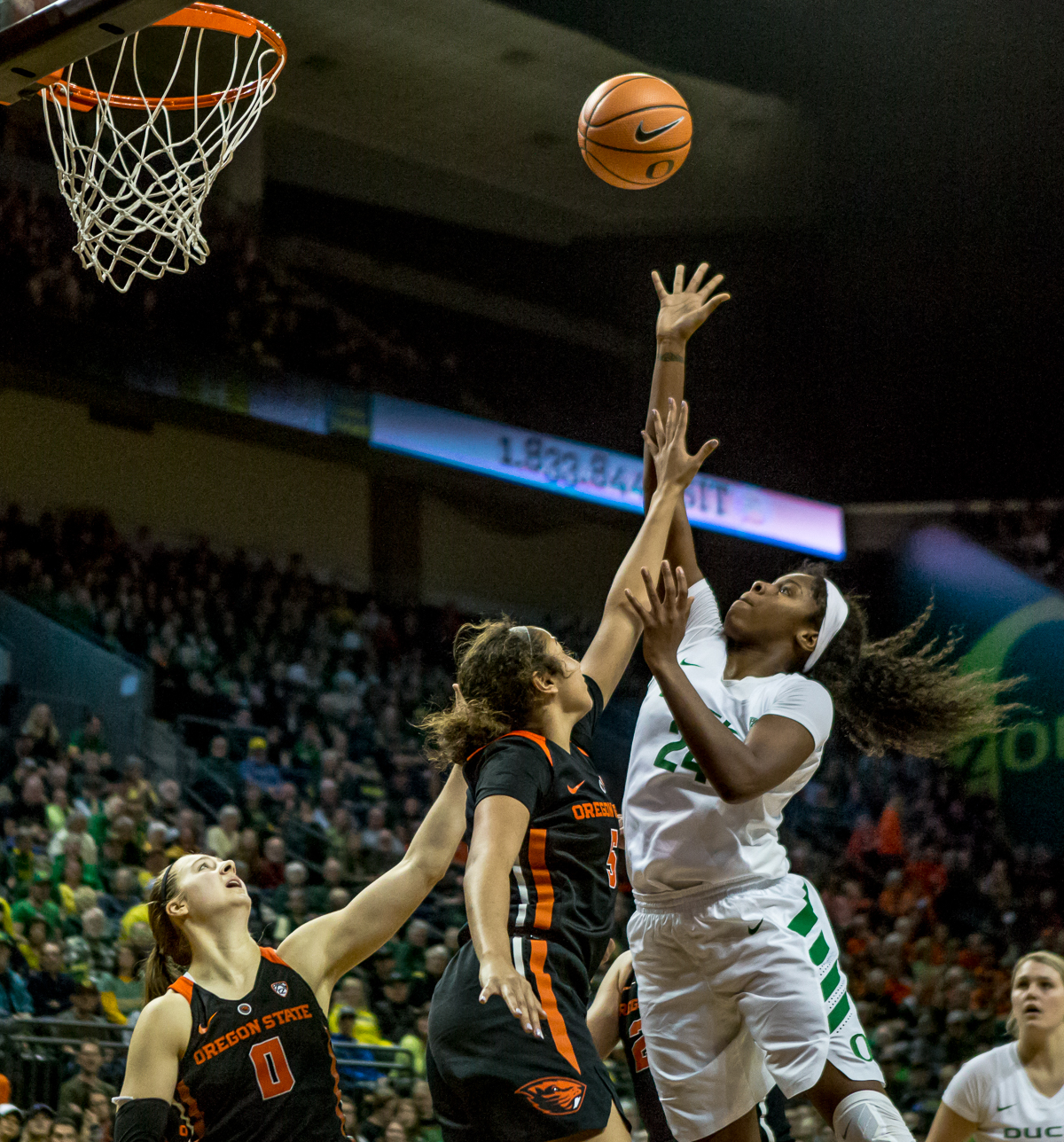 Oregon forward Ruthy Hebard (#24) leaps to rebound an Oregon State shot. The Oregon Ducks defeated the Oregon State Beavers 75-63 on Sunday afternoon in front of a crowd of 7,249 at Matthew Knight Arena. The Ducks and Beavers split the two game Civil War with the Beavers defeating the Ducks on Friday night in Corvallis. The Ducks had four players in double digits: Satou Sabally with 21 points, Maite Cazorla with 16, Sabrina Ionescu with 15, and Mallory McGwire with 14. The Ducks shot 48.4% from the floor compared to the Beavers 37.3%. The Ducks are now 7-1 in conference play. Photo by Ben Lonergan, Oregon News Lab