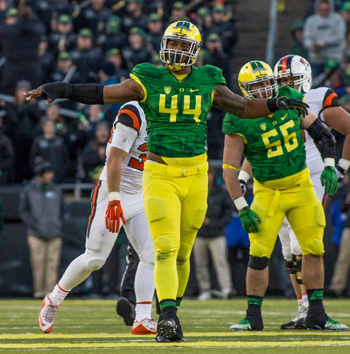 Oregon Ducks DeForest Buckner (#44) celebrates after sacking Oregon State Beavers quarterback Marcus McMaryion (#3). The Oregon Ducks beat the Oregon State Beavers 52-42 in the 119th Civil War for the eighth year in a row at Autzen Stadium on Friday afternoon. Katie Pietzold, Oregon News Lab