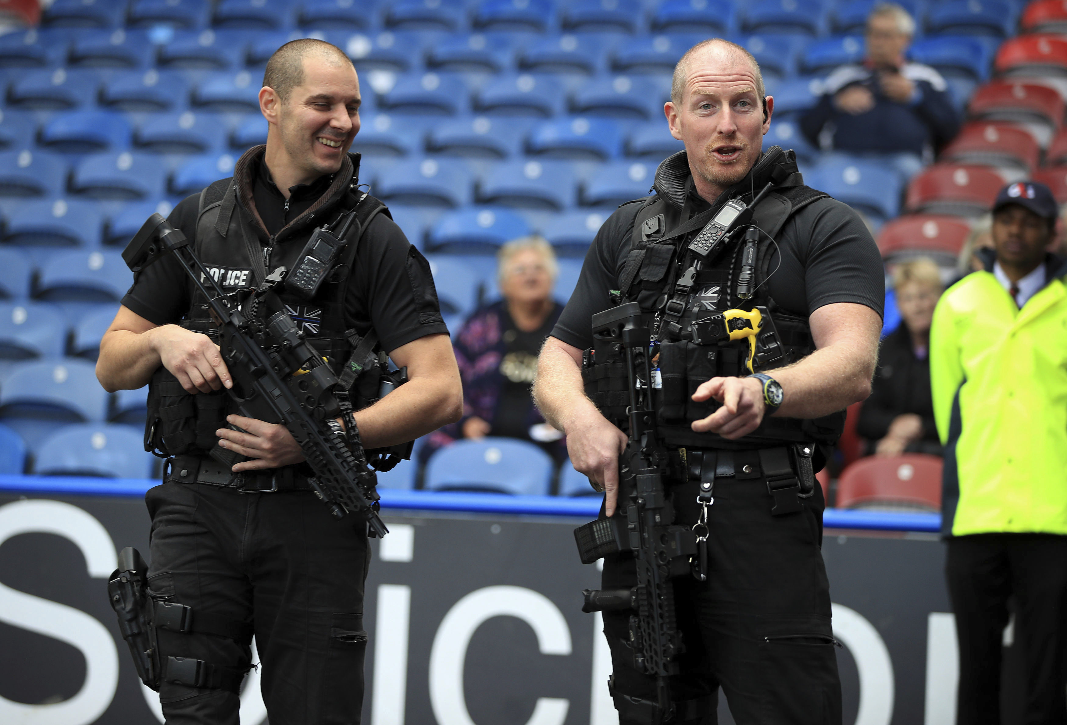 "Armed police provide security before the English Premier League soccer match at the John Smith's Stadium in Huddersfield, England, Saturday Sept. 16, 2017.  There are hundreds of troops and armed police deployed at public sites throughout Britain to beef up security, as British officials left the terrorist threat warning level at ""critical,"" following Friday's subway blast in London. (Mike Egerton/PA via AP)"