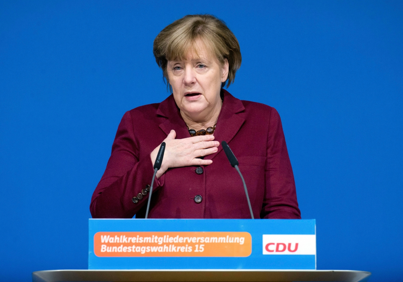 German Chancellor Angela Merkel delivers a speech at a local meeting of her Christian Democrats, CDU, in Grimmen, northern Germany, Saturday, Jan. 28, 2017. Merkel said there's no solution yet to the problem of how to fairly share the burden of migration among European Union member states. (Stefan Sauer/dpa via AP)