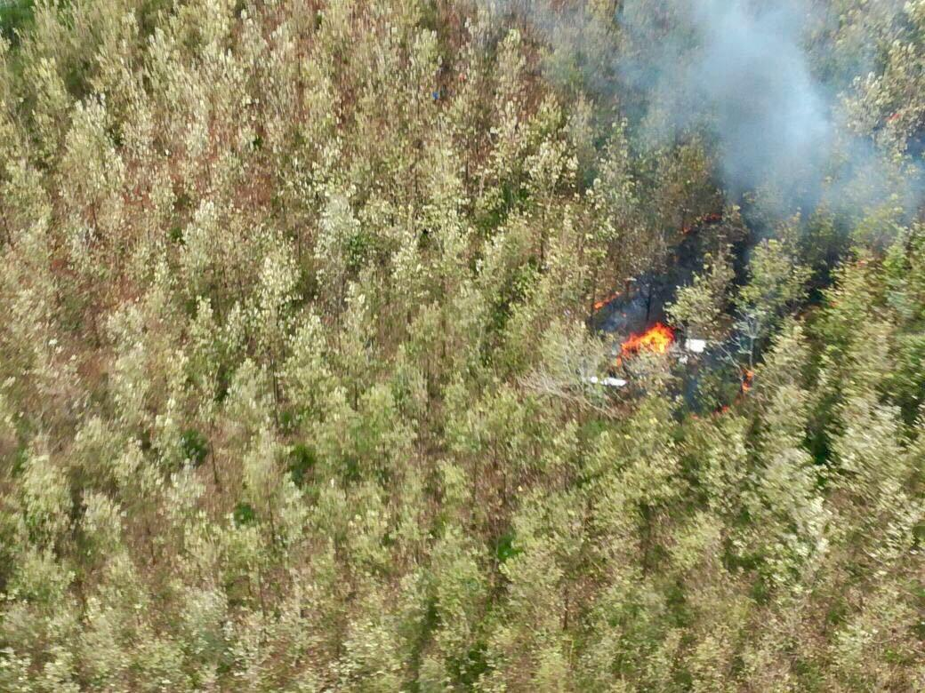 This photo released by Costa Rica's Public Safety Ministry shows smoke rising from the site of a plane crash in Punta Islita, Guanacaste, Costa Rica, Sunday, Dec. 31, 2017. (Costa Rica's Public Safety Ministry via AP)