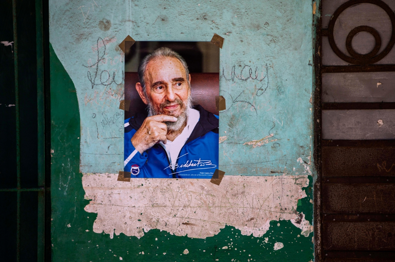A poster of Cuban Revolution leader Fidel Castro is seen on a wall in Havana, Cuba, Saturday, Aug. 13, 2016. As Castro celebrates his 90th birthday, the Cuban government has taken a low-key approach to Castro's birthday. There are no massive rallies or parades planned, no publicly announced visits from global dignitaries. (AP Photo/Desmond Boylan)