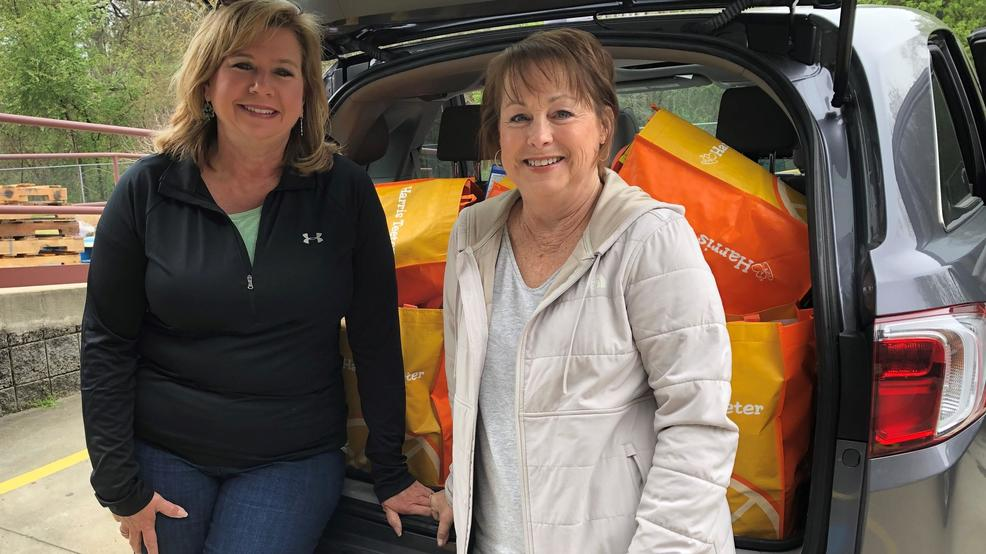 Karen Latta and Lane Morgan of Grace Raleigh Church with donation of 45+ bags of food for emergency food assistance..jpg