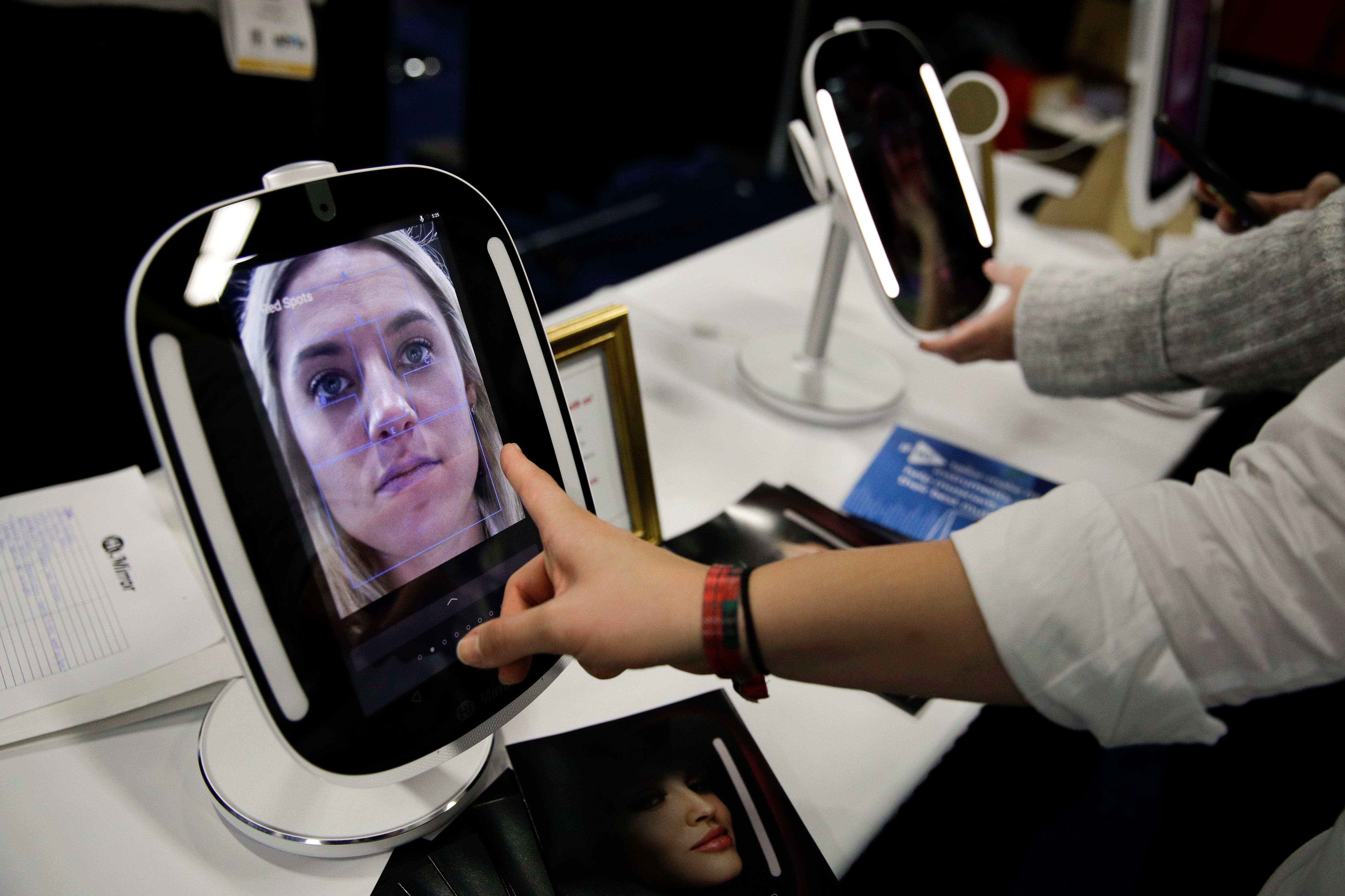 The HiMirror Mini, an internet-connected smart mirror with Amazon's Alexa, is displayed during CES Unveiled at CES International Sunday, Jan. 7, 2018, in Las Vegas. (AP Photo/Jae C. Hong)