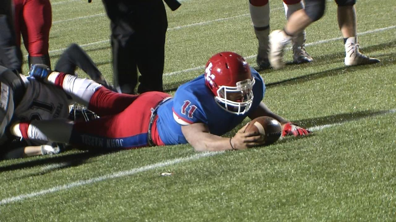 John Marshall gets a long run from #11 Devonte Lee and then has the ball on Perkins-Tryon's 1-yard line (Ivan Gibson / KOKH)