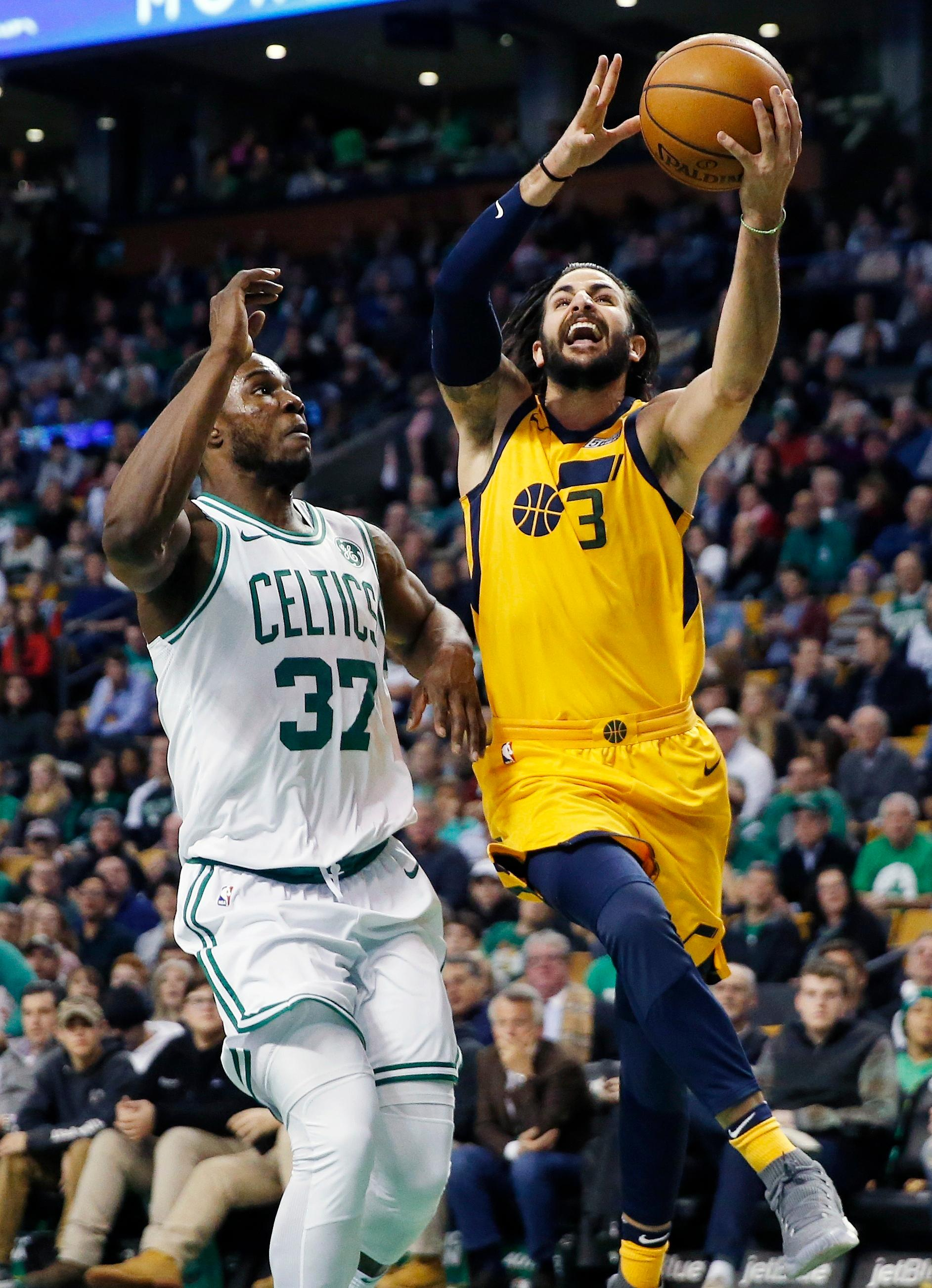 Utah Jazz's Ricky Rubio (3) goes up to shoot against Boston Celtics' Semi Ojeleye (37) during the first quarter of an NBA basketball game in Boston, Friday, Dec. 15, 2017. (AP Photo/Michael Dwyer)