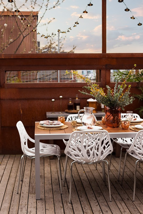 Summer is here, which means it's time to take the rain covers off the barbecue and dust off that table set! But not everyone can make an adorable Pinterest-worthy outdoor dining area, so we asked Porch, ATGStores.com and Wayfair (the true experts) to help us pick some pieces that take dining in your backyard to the next level. (Image: ATGStores.com)