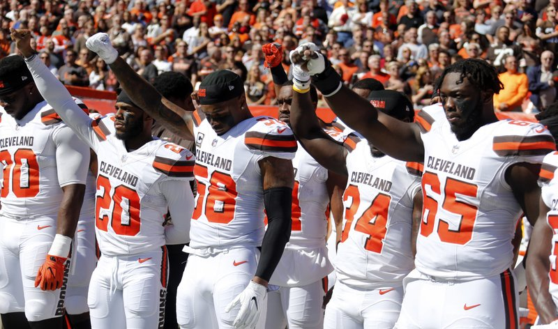 Cleveland BrownsÂ?teammates raise their fists during the national anthem before an NFL football game against the Cincinnati Bengals, Sunday, Oct. 1, 2017, in Cleveland. (AP Photo/Ron Schwane)