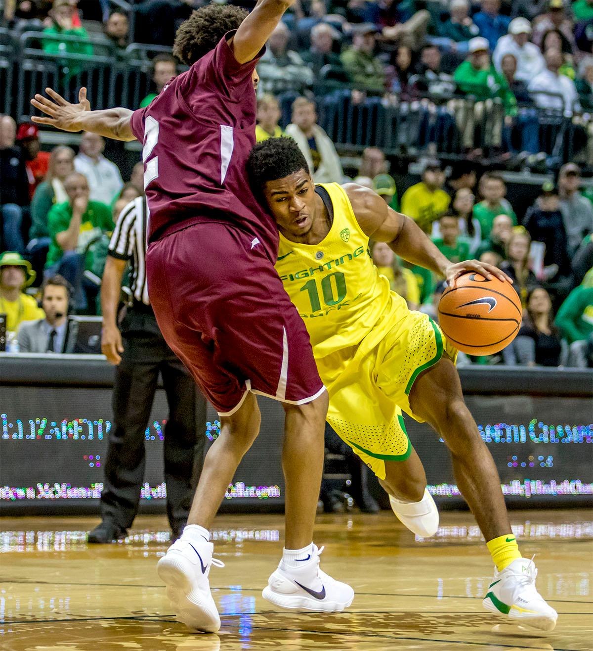 The Duck's Victor Bailey Jr. (#10) makes a run for the basket. The Oregon Ducks defeated Texas Southern Tigers 74-68. The Ducks are now 7-3 overall in the Pac-12. Photo by August Frank. Oregon News Lab