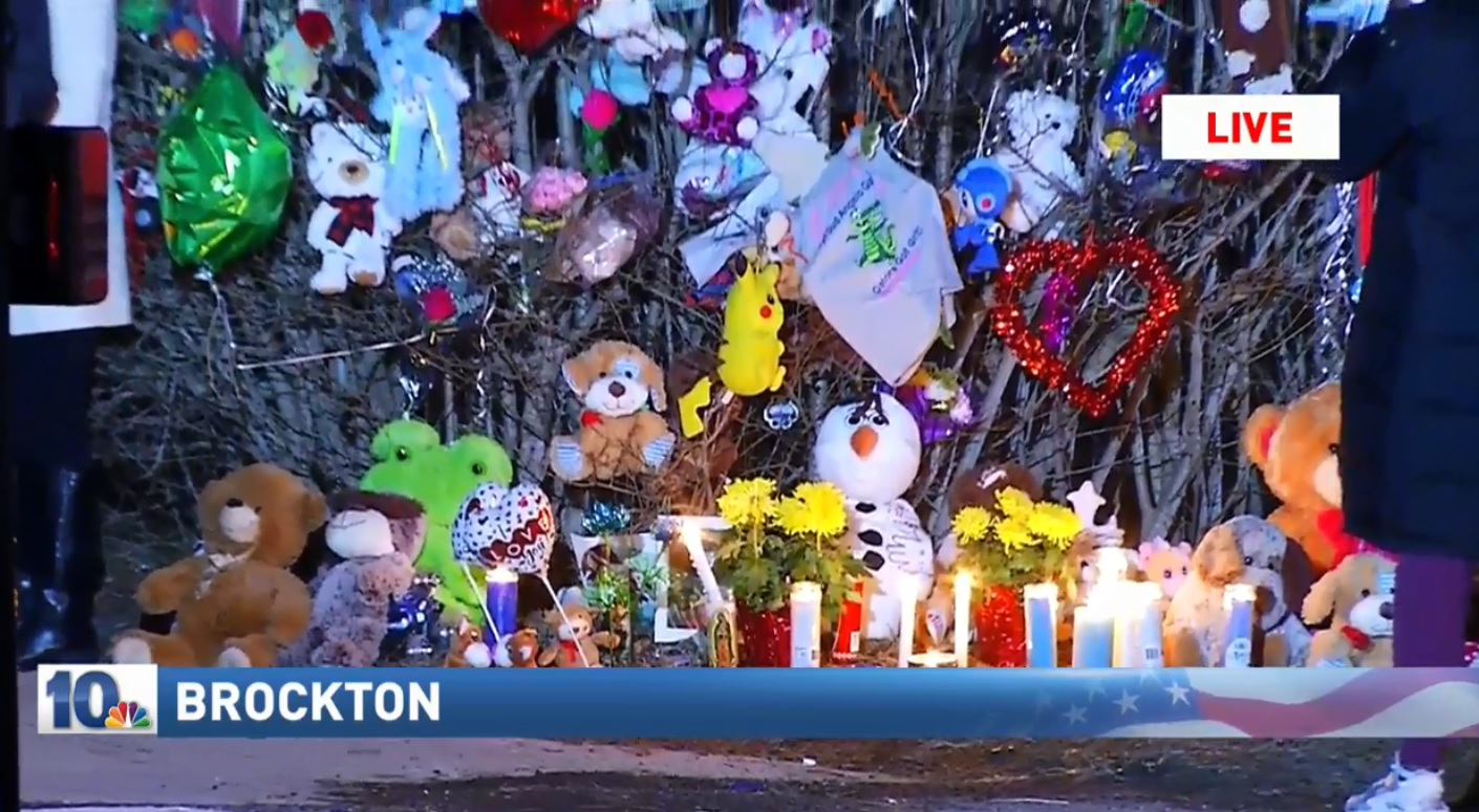 A candlelight vigil was held in Brockton on Thursday, Feb. 8, 2018, to remember two boys who prosecutors said were killed by their mother. (WJAR)