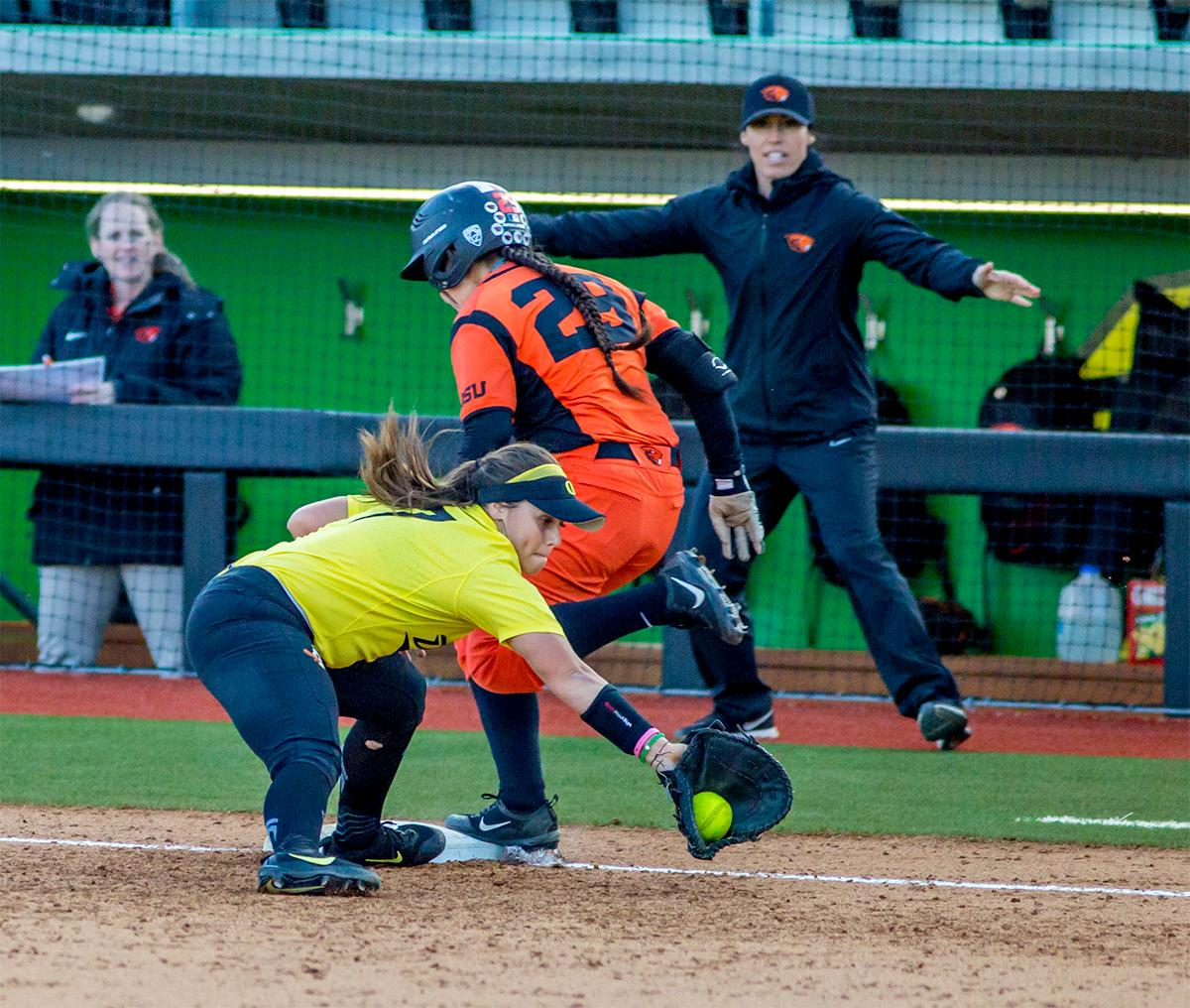 The Beavers' Lovie Lopez (#29) hits the base safe. The Oregon Ducks defeated the Oregon State Beavers 8-0 in game one of the three-game Civil War series on Friday night at Jane Sanders Stadium. The game was 0-0 until Gwen Svekis (#21) hit a solo home run in the fourth inning. Mia Camuso hit a grand slam in the fifth inning, ending the game for the Ducks by mercy rule. With tonight's victory, the Ducks are 39-6 and 12-6 in Pac-12 play. Photo by August Frank, Oregon News Lab