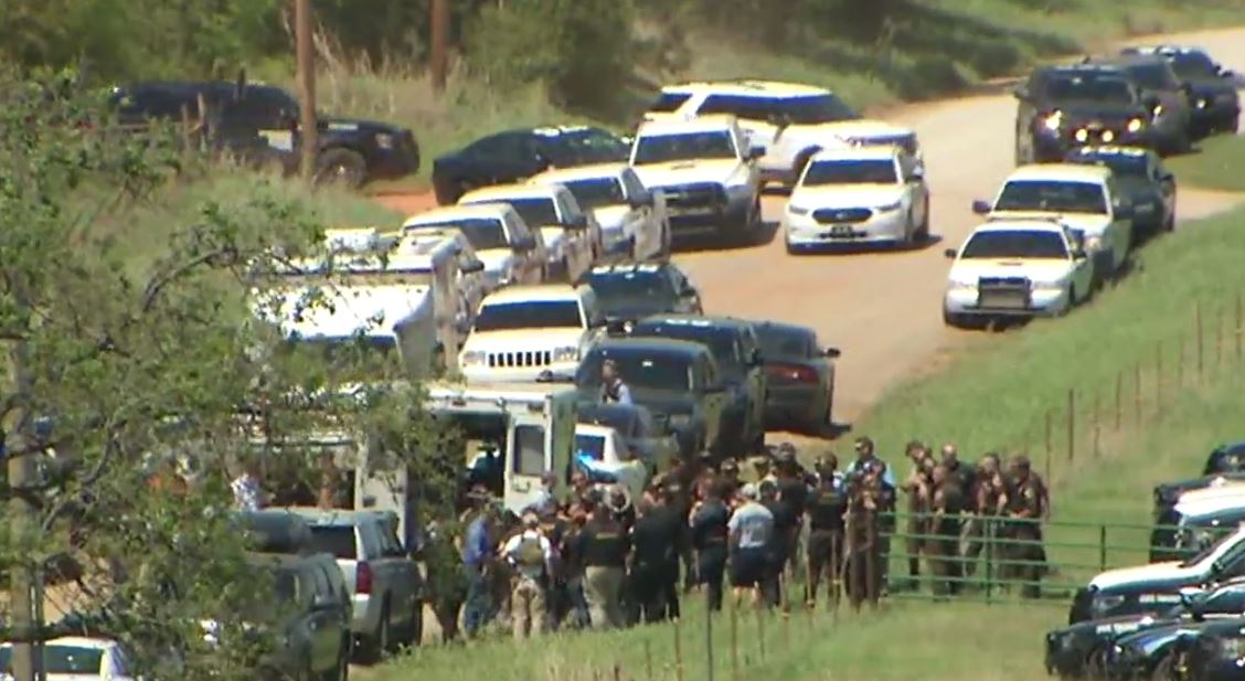 A large law enforcement presence on scene near CR 76 and Jaxton as officers search for a man that allegedly shot and killed a deputy. (KOKH/Colleen Wilson)