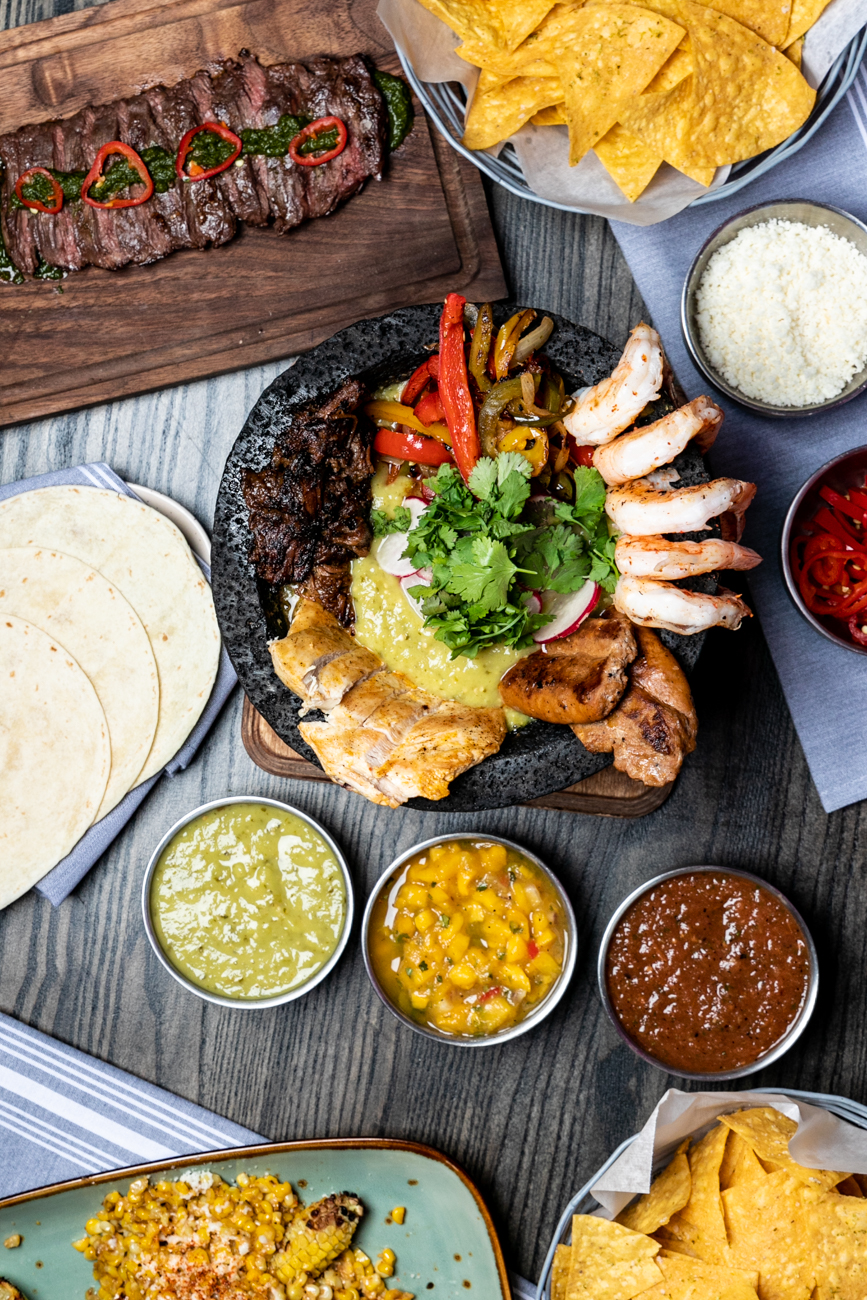 Molcajete: shrimp, brisket, chicken, chorizo sausage link, roasted peppers, cotija, cilantro, and pickled fresno served with white corn tortillas / Image: Amy Elisabeth Spasoff // Published: 1.5.20