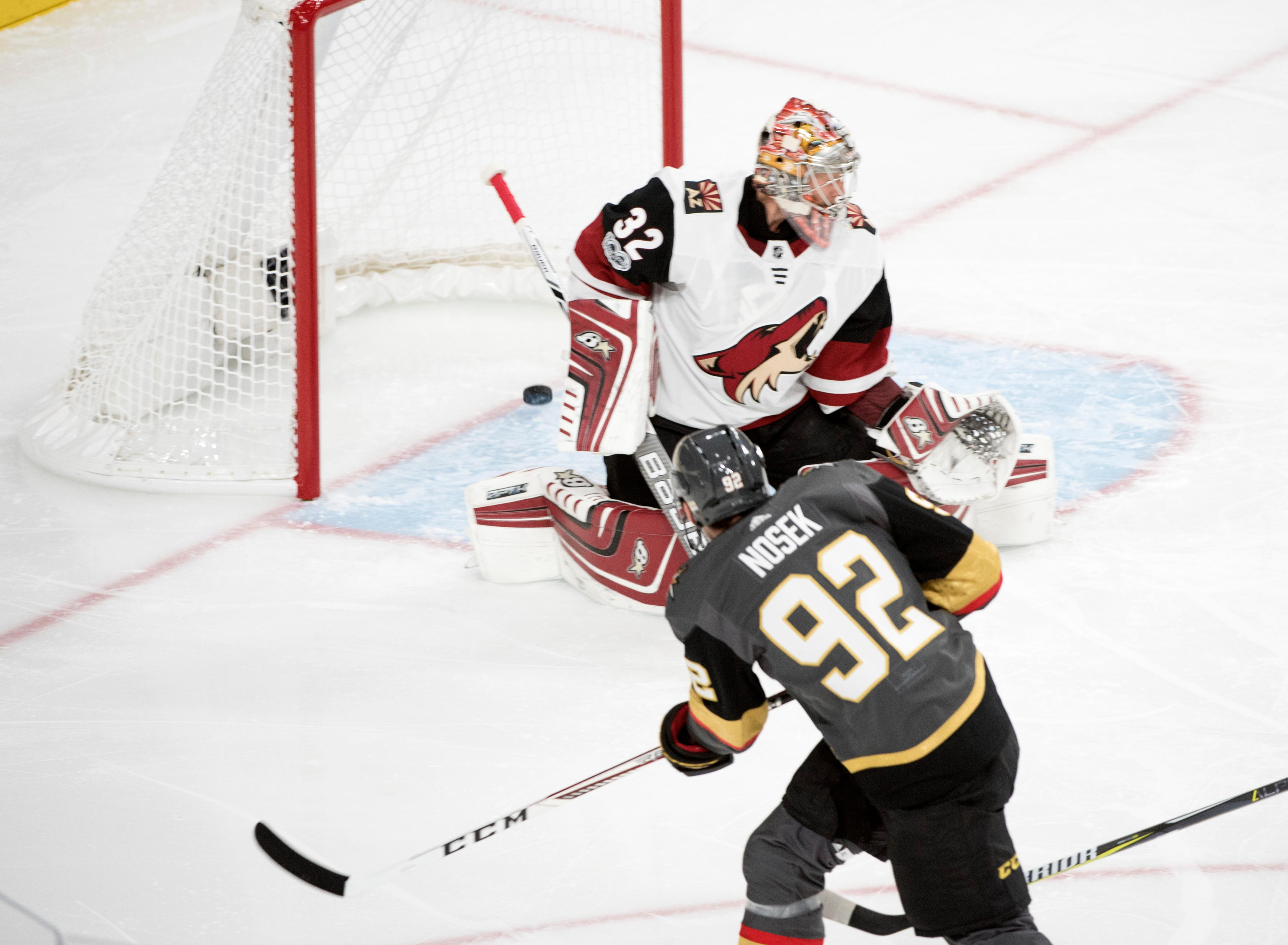 Vegas Golden Knights left wing Tomas Nosek (92) gets the puck past Arizona Coyotes goalie Antti Raanta (32) for their first home goal during the Knights home opener Tuesday, Oct. 10, 2017, at the T-Mobile Arena. The Knights won 5-2 to extend their winning streak to 3-0. CREDIT: Sam Morris/Las Vegas News Bureau